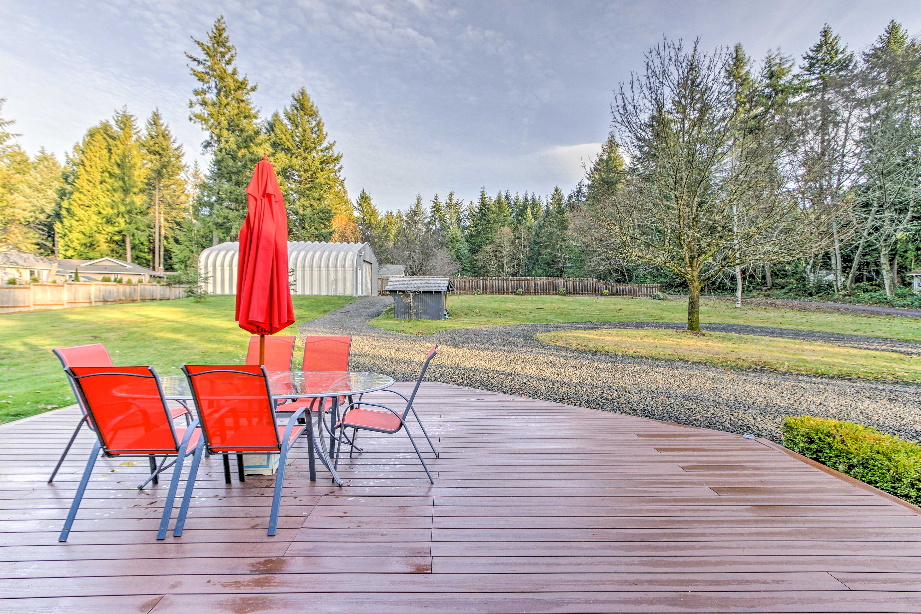 Relax on your private deck overlooking the beautiful yard.