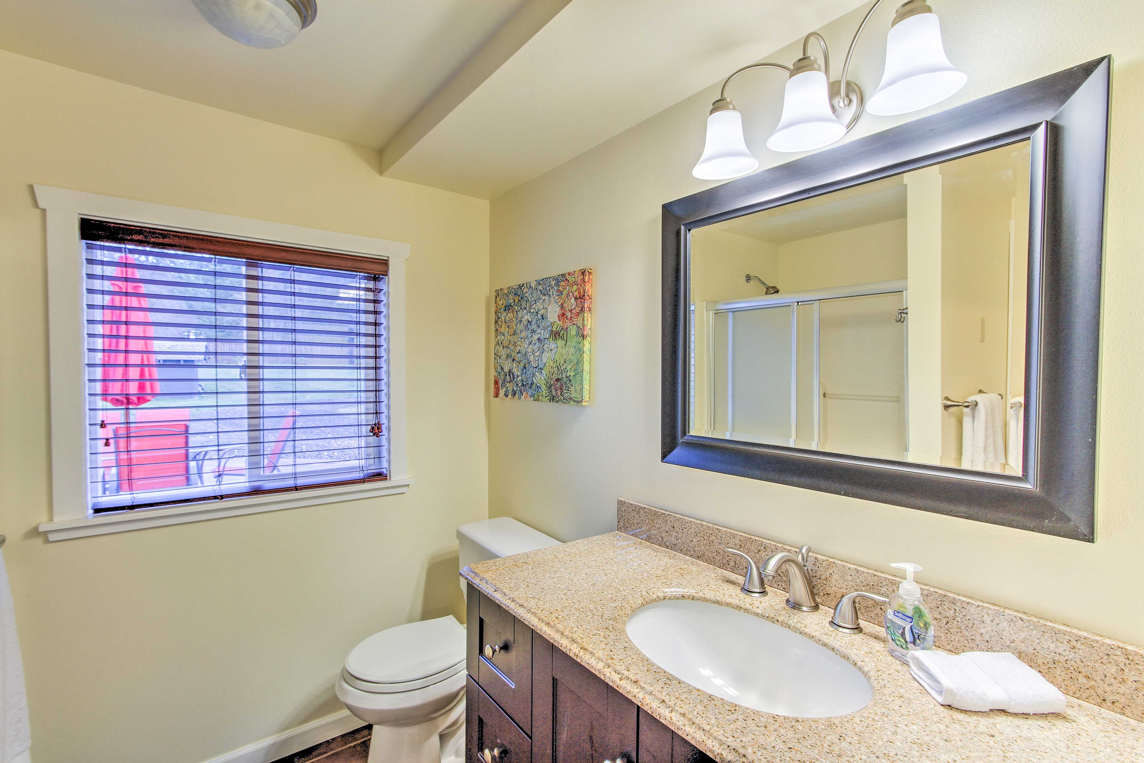 Rinse off in the walk-in shower of the first bathroom.