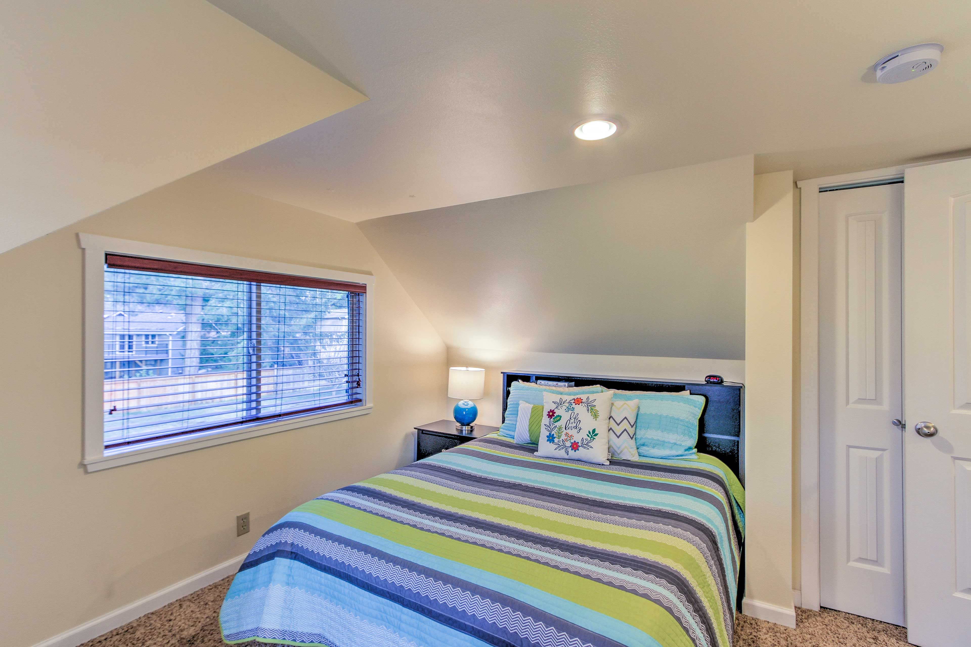 Climb under the covers of the queen bed in the second bedroom.