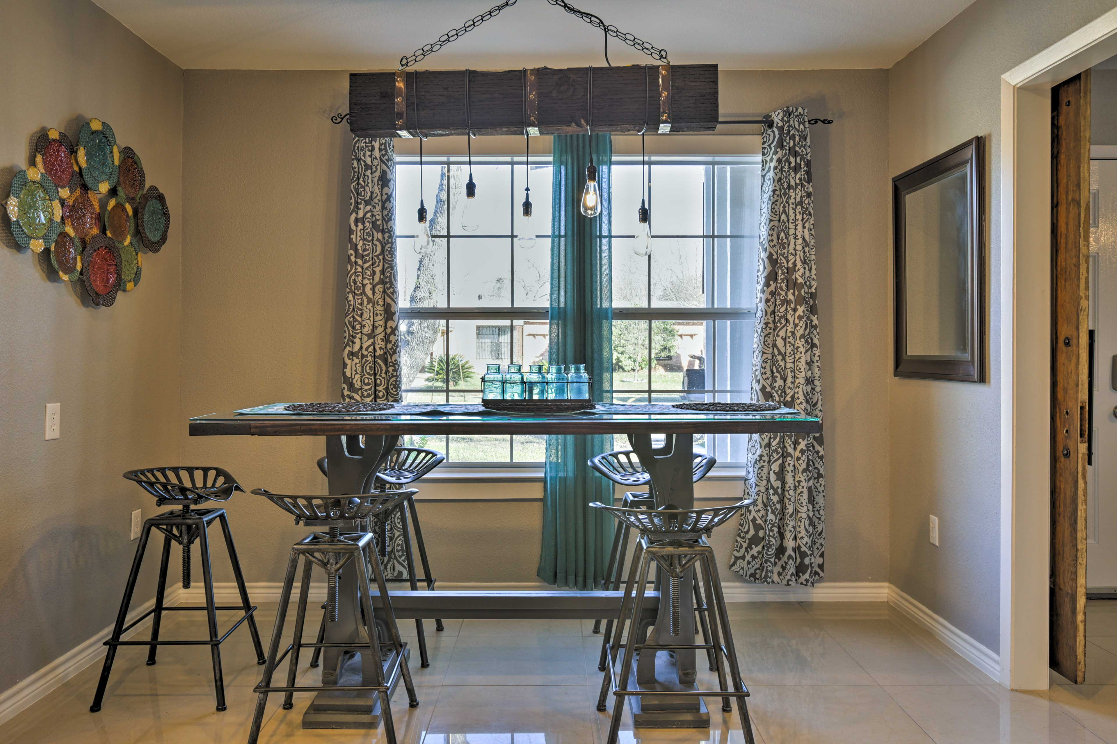 Serve home-cooked cuisine at this trendy high-top table.