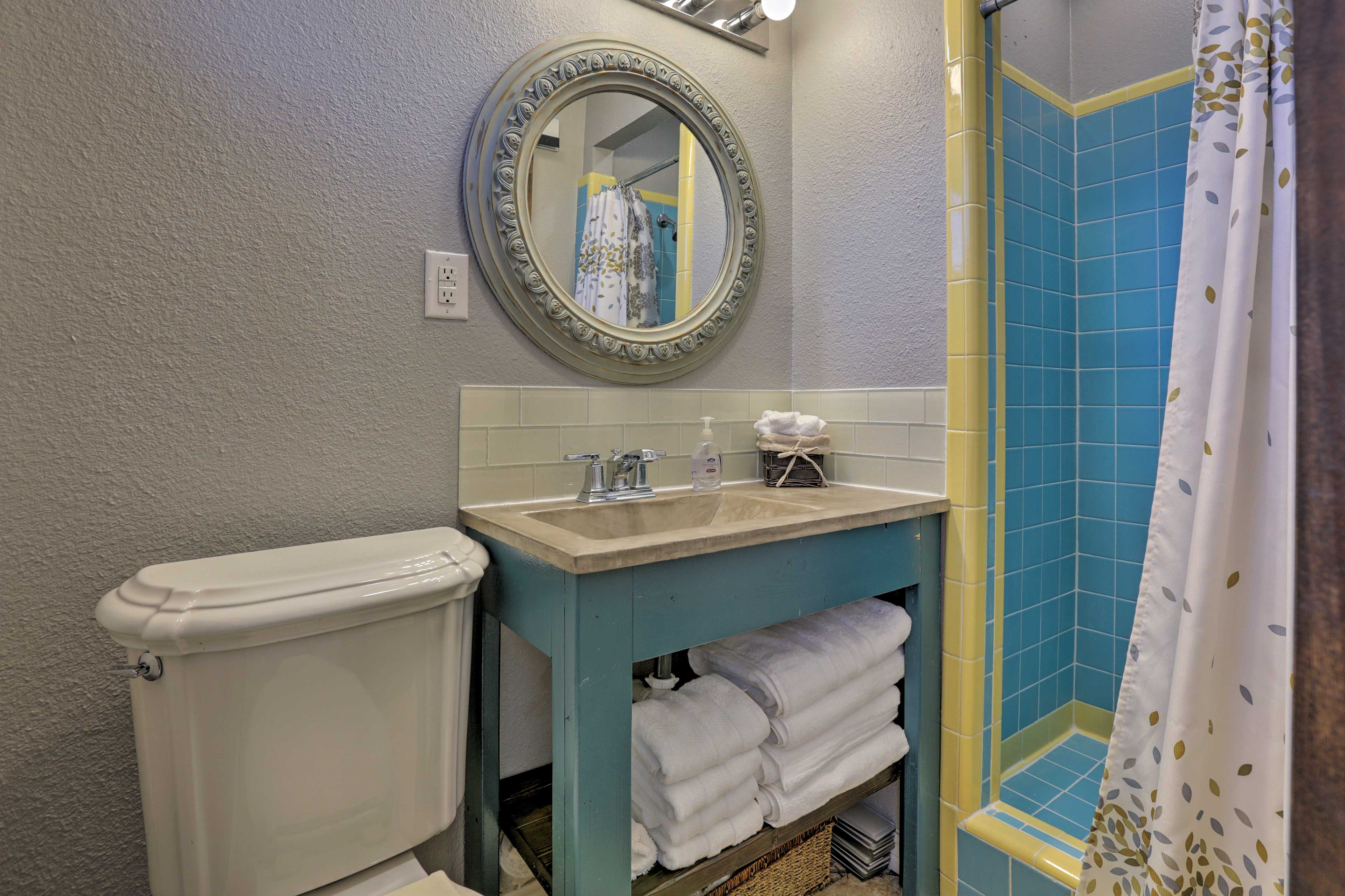 This second bathroom features a walk-in shower.