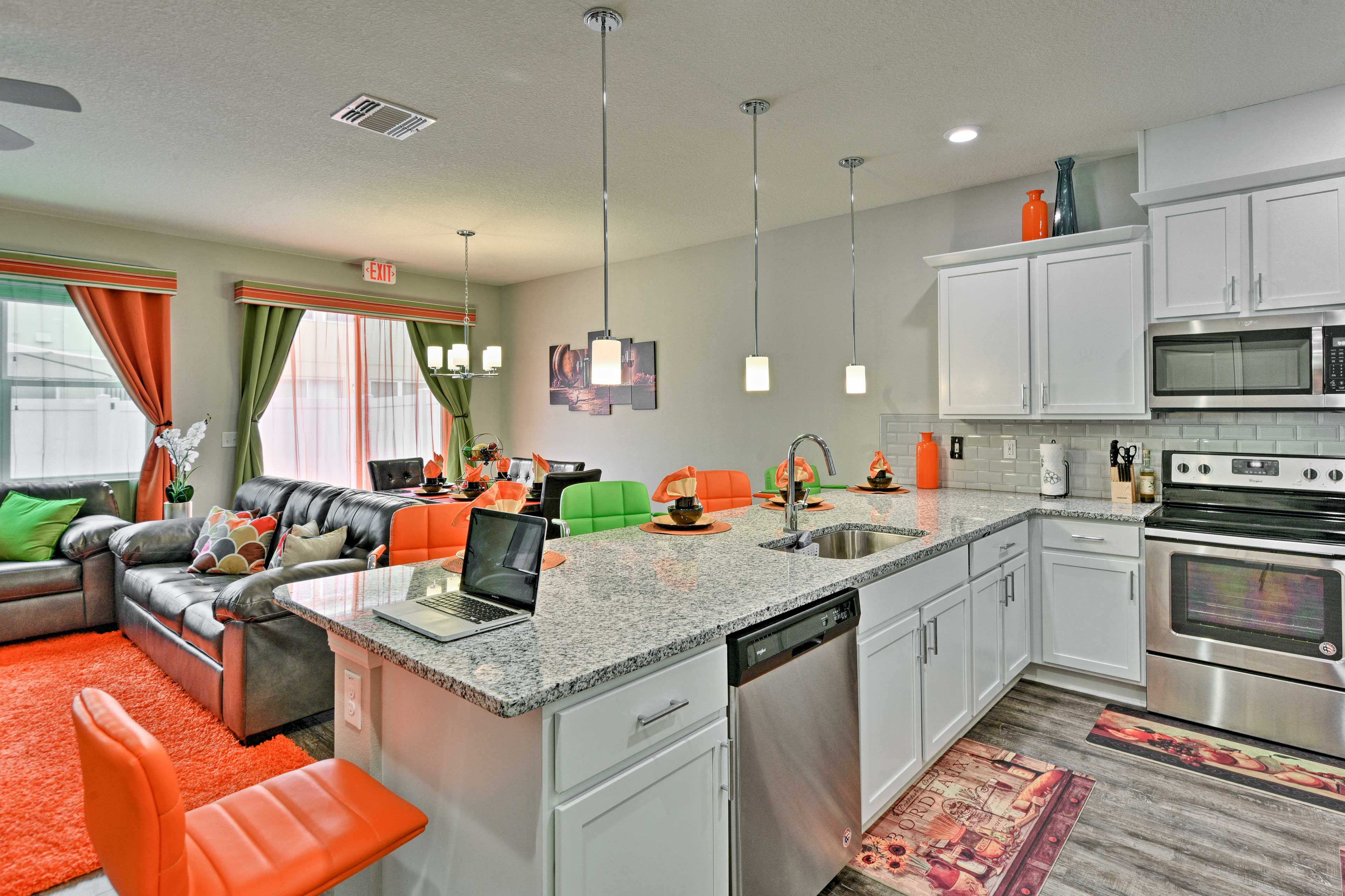 This modern kitchen comes fully equipped with new stainless steel appliances.