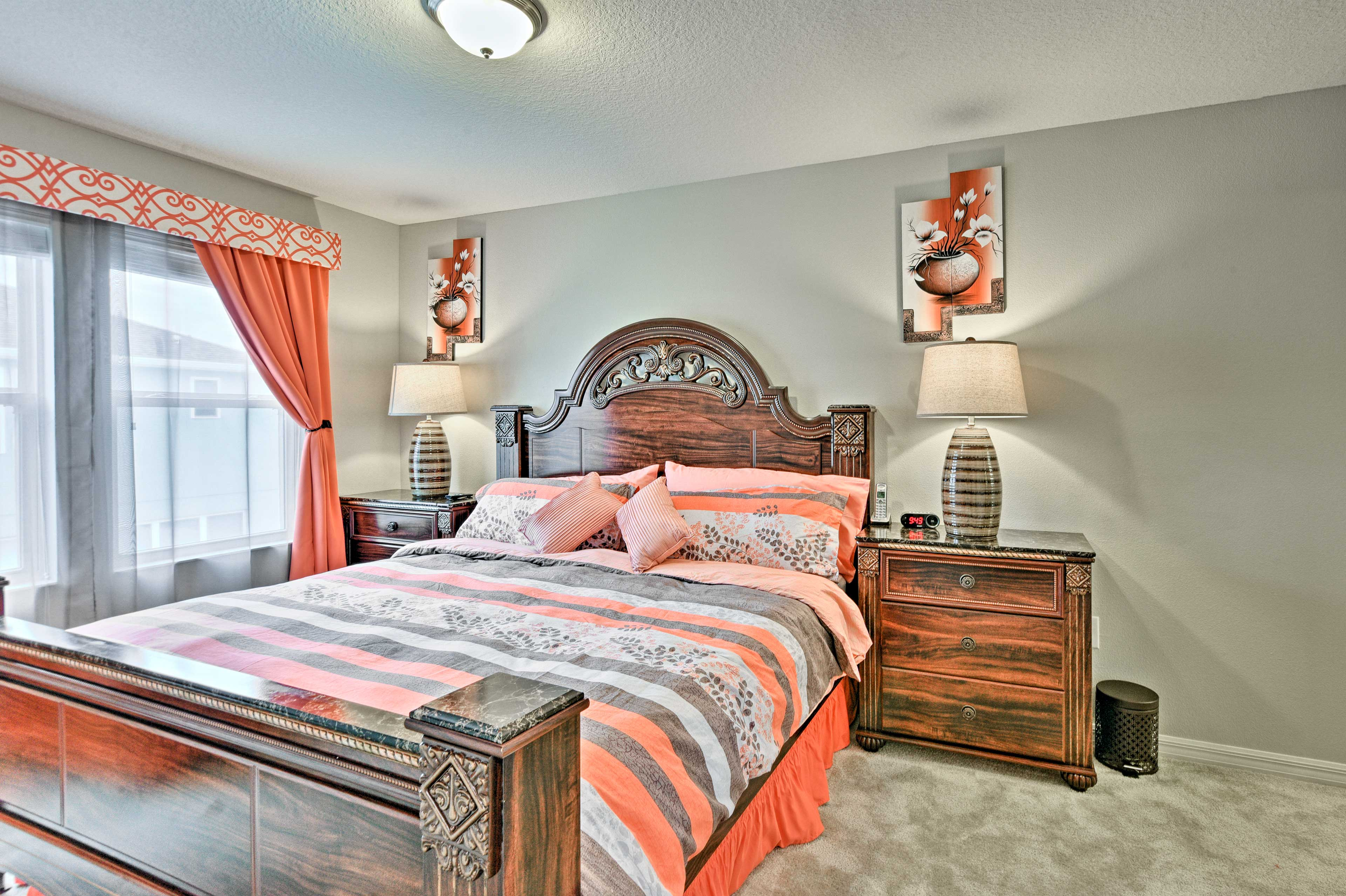 The first bedroom features a king bed and en-suite bath.