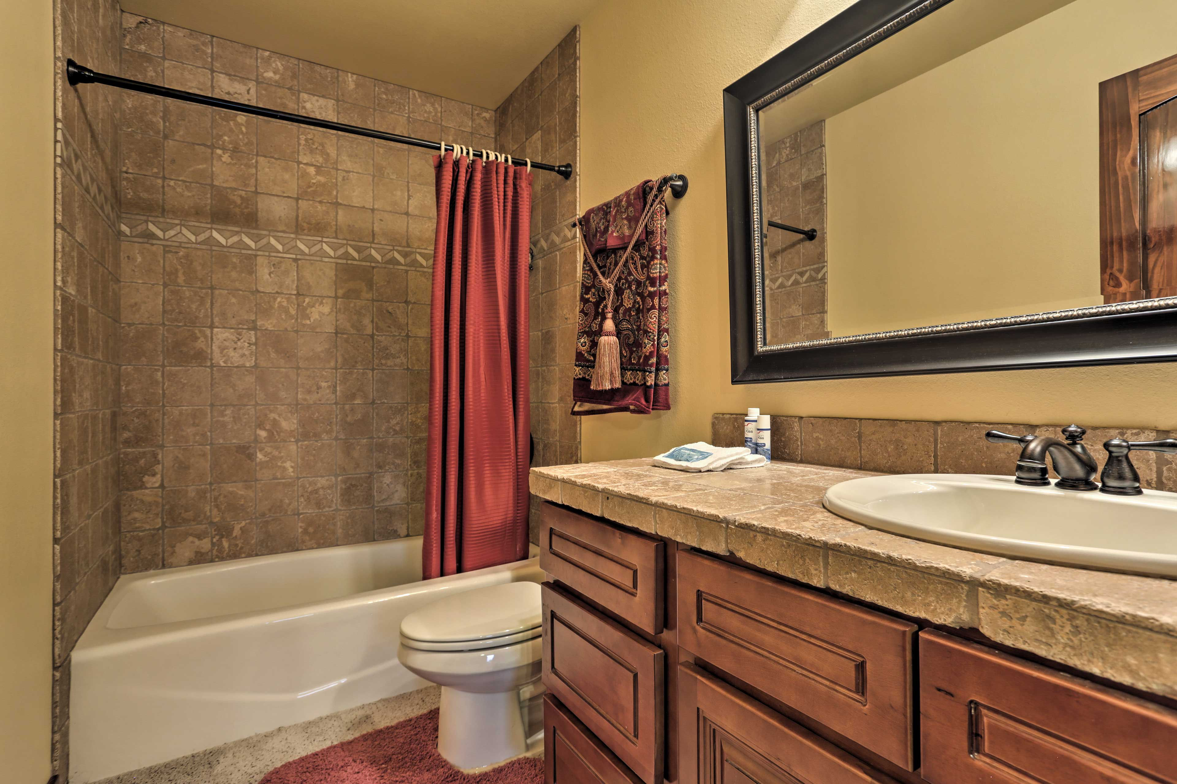 The 2 full bathrooms are stocked with complimentary toiletries and fresh towels.