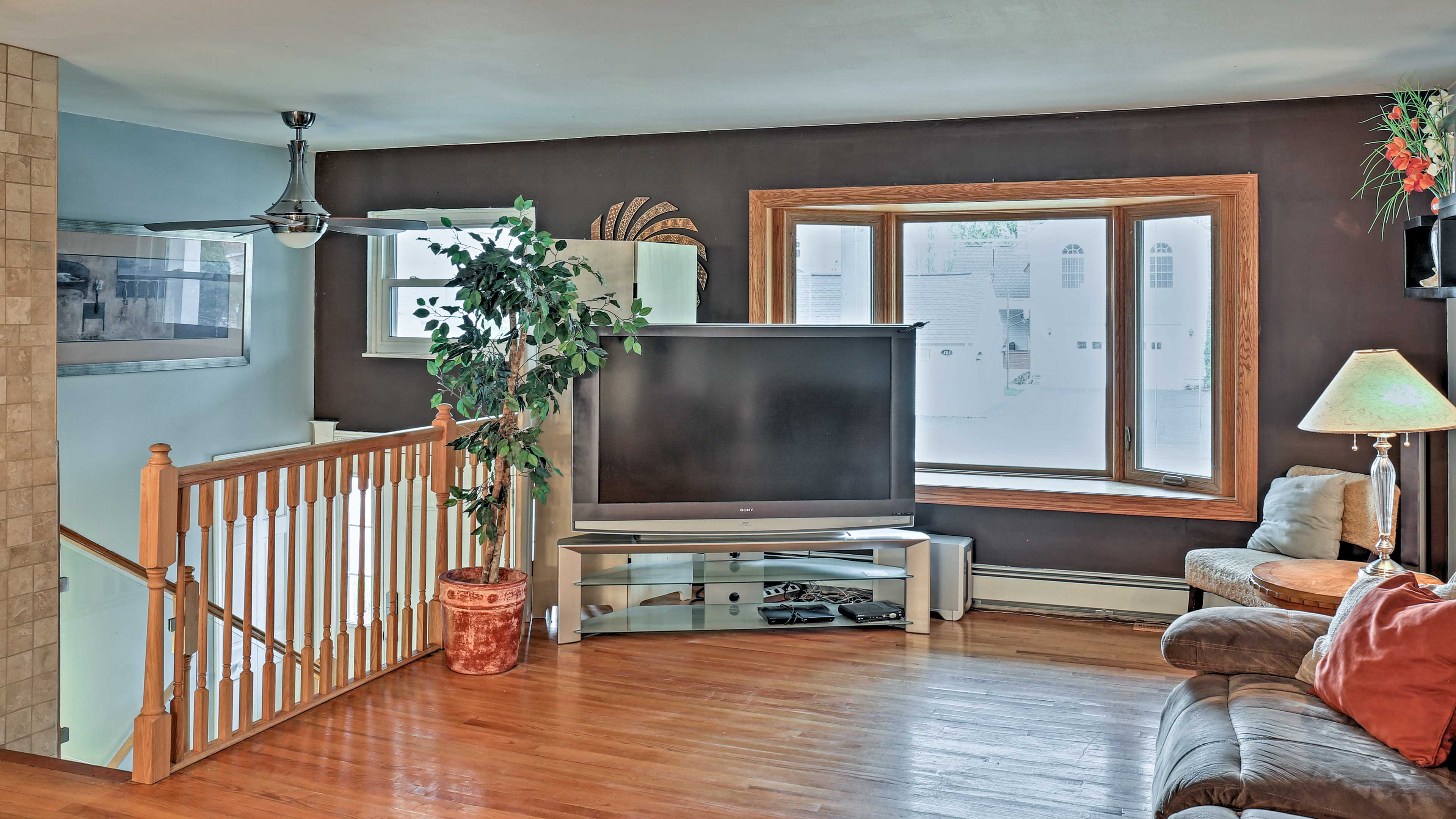 Watch your favorite DVD on the 55-inch TV upstairs.