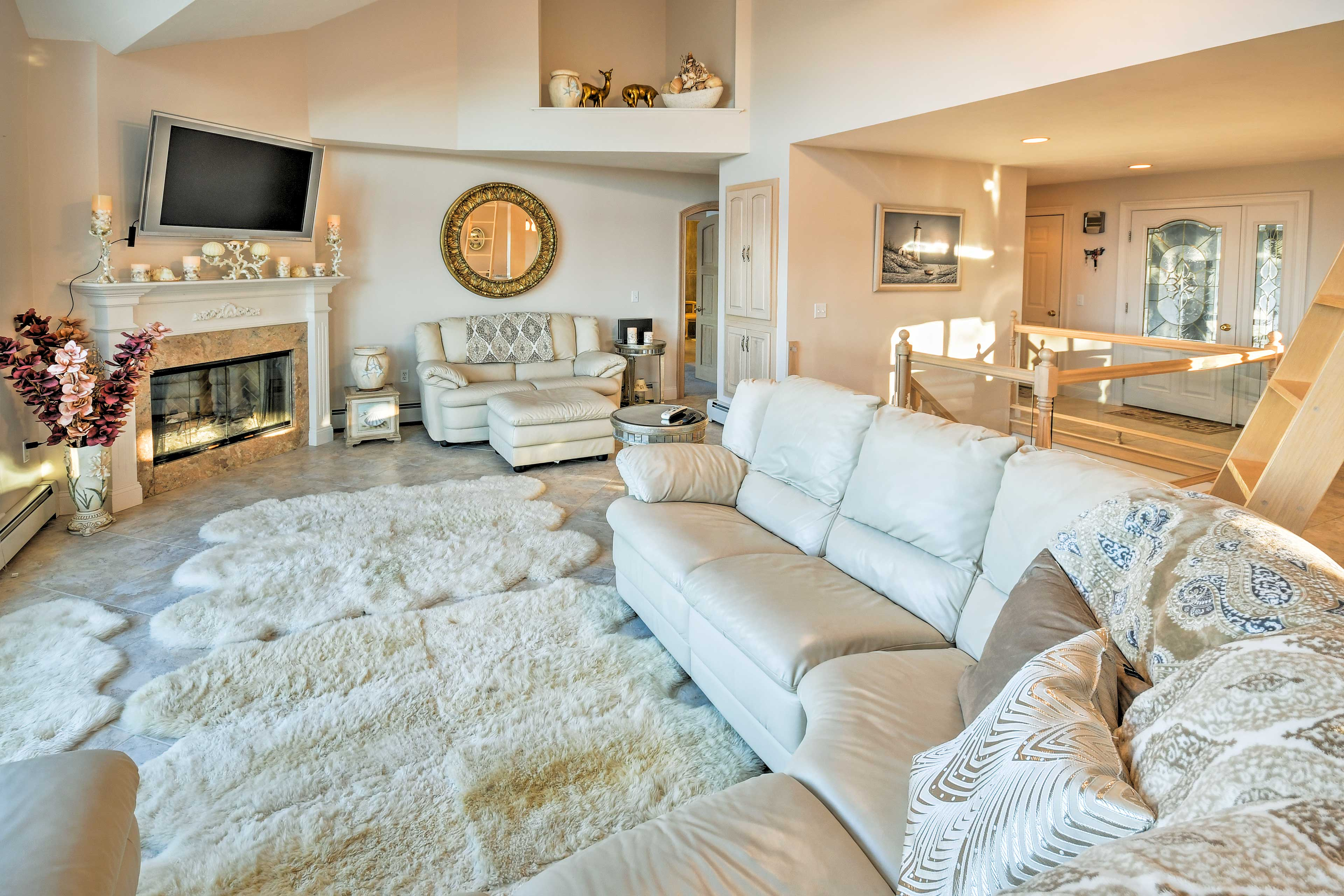 Warm up around the wood-burning fireplace in the living room as a movie plays.