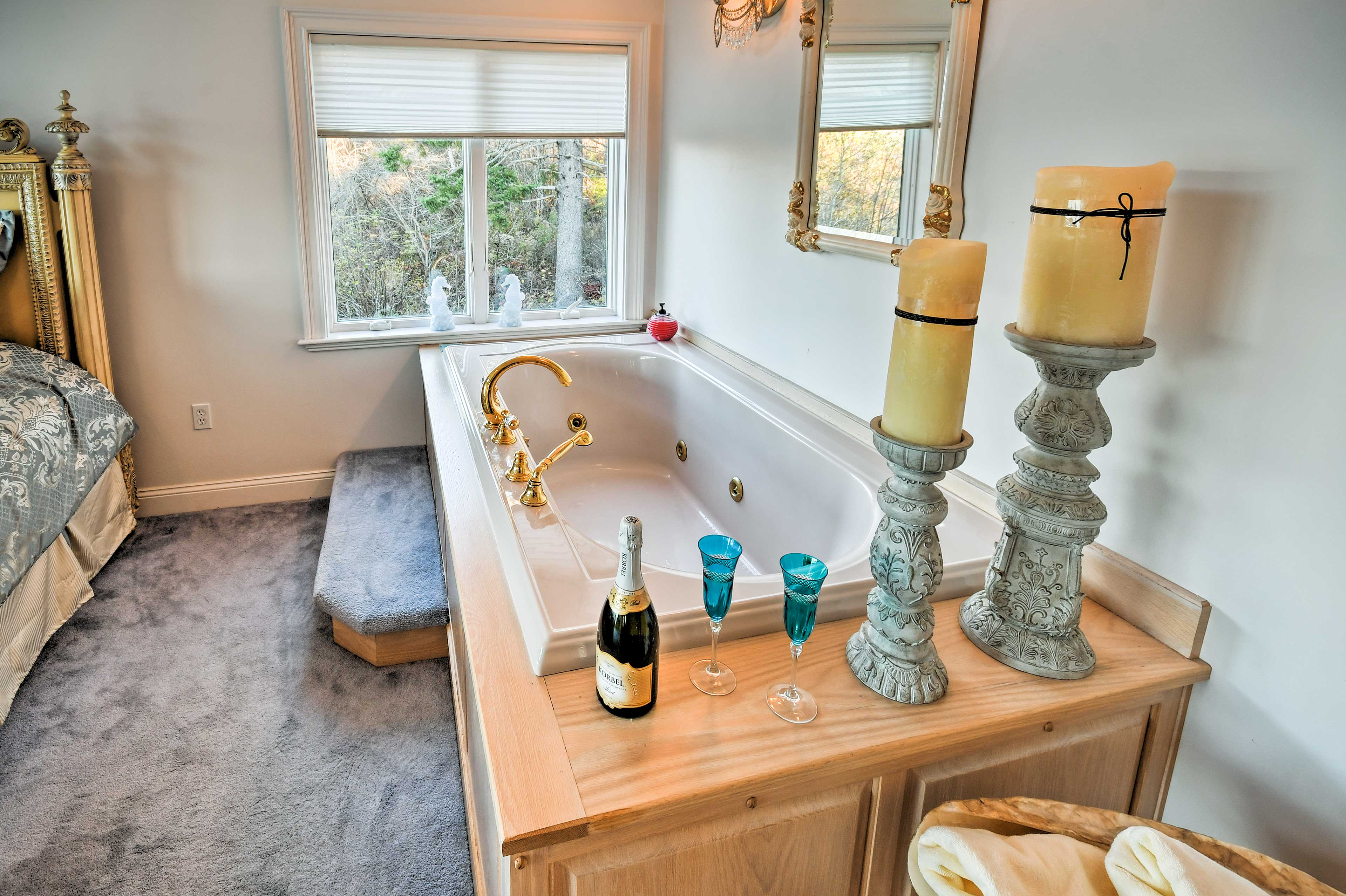 Pop the bubbly as you relax in a bubble bath in the master bedroom.
