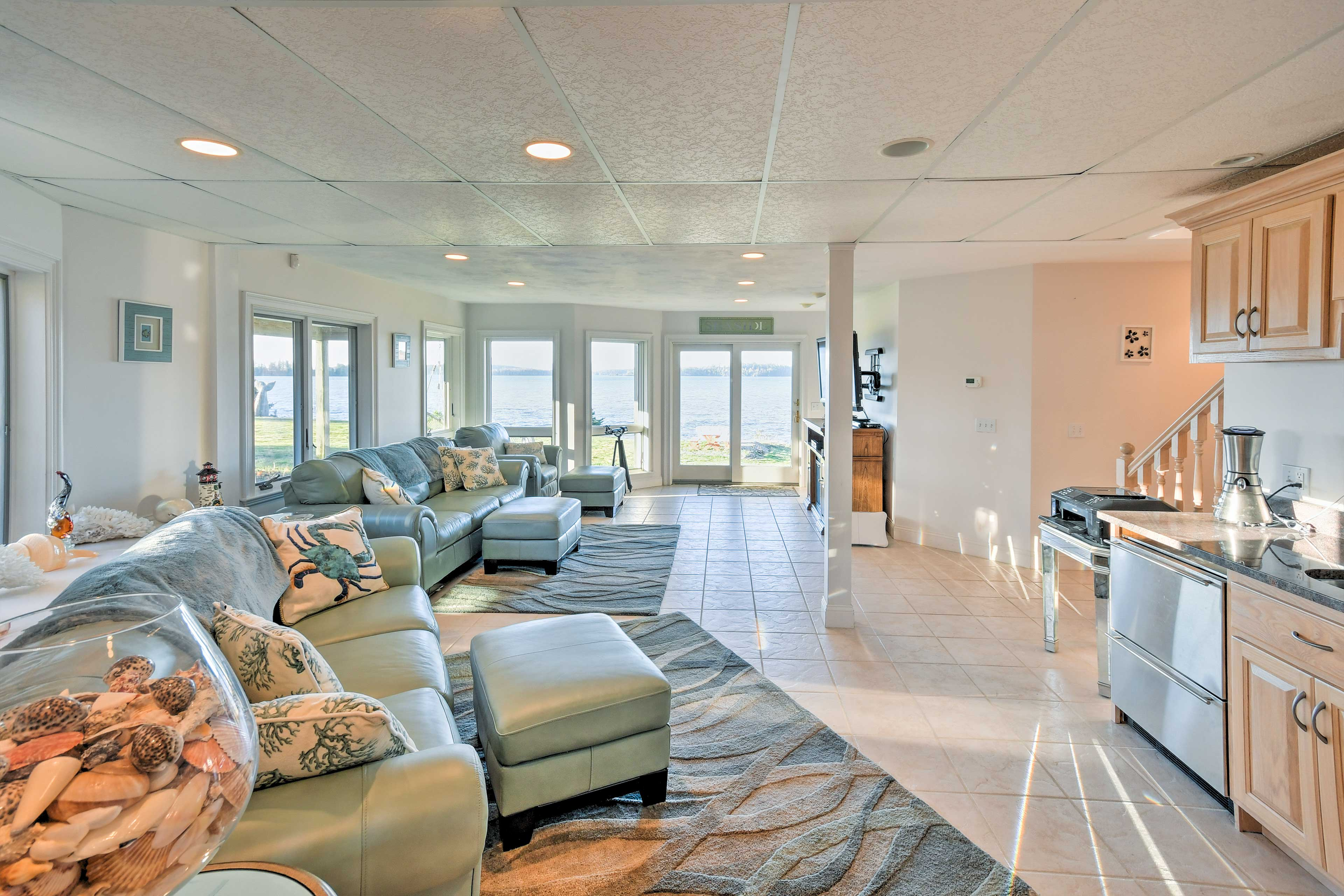 Hang out in the family room, complete with a kitchenette and patio access.
