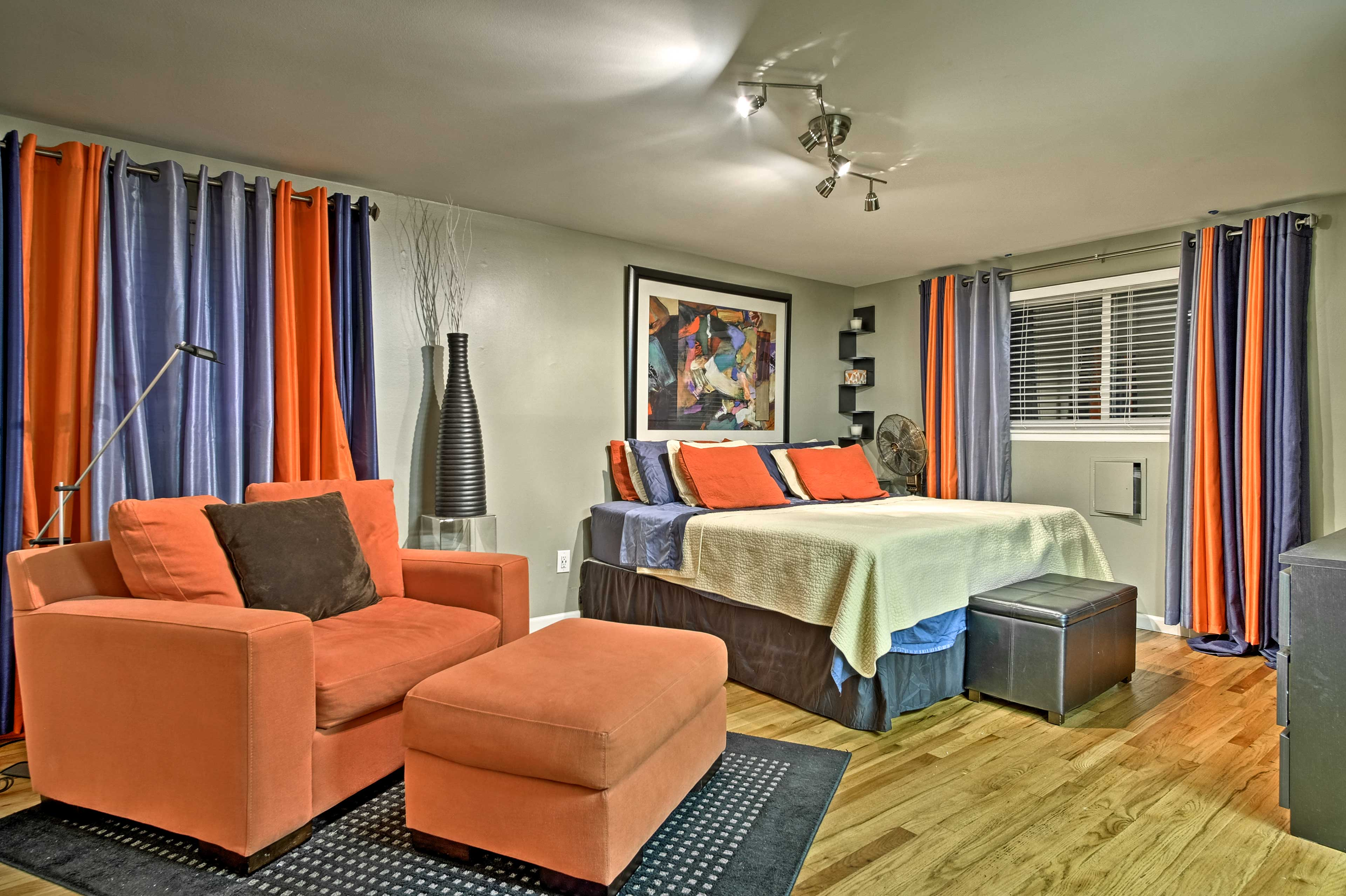 The master bedroom comes complete with a king bed and cozy sitting area.