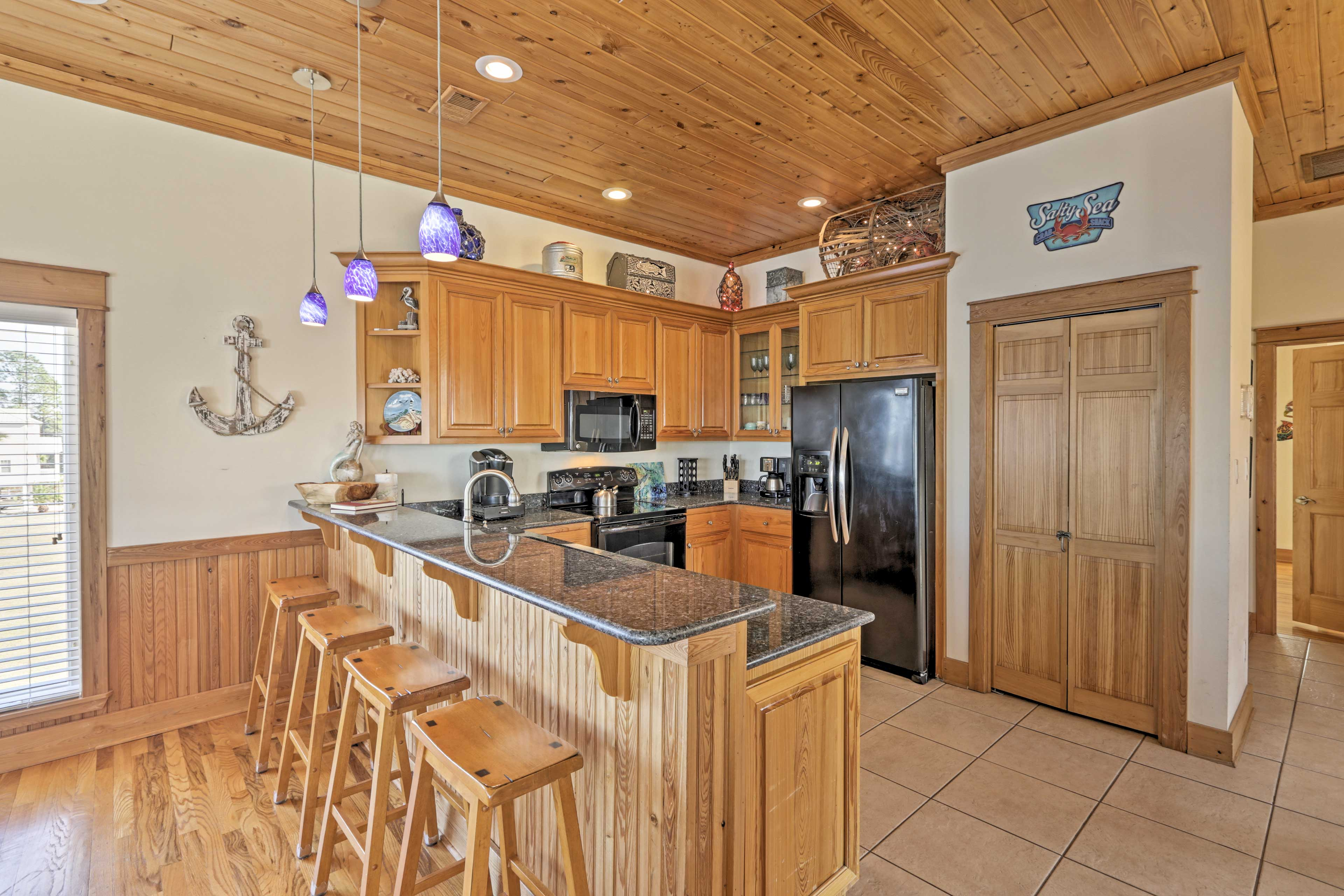 Entertain guests at the bar counter set for 4.