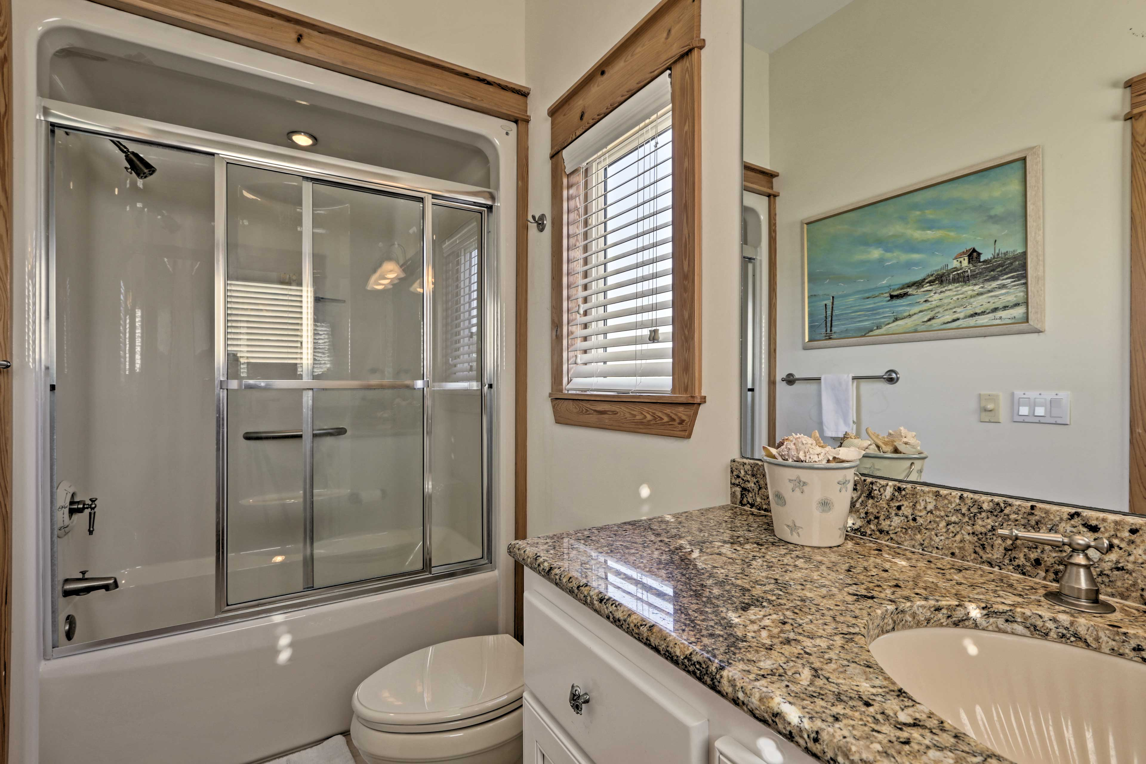 Rinse off in this tub/shower combo.