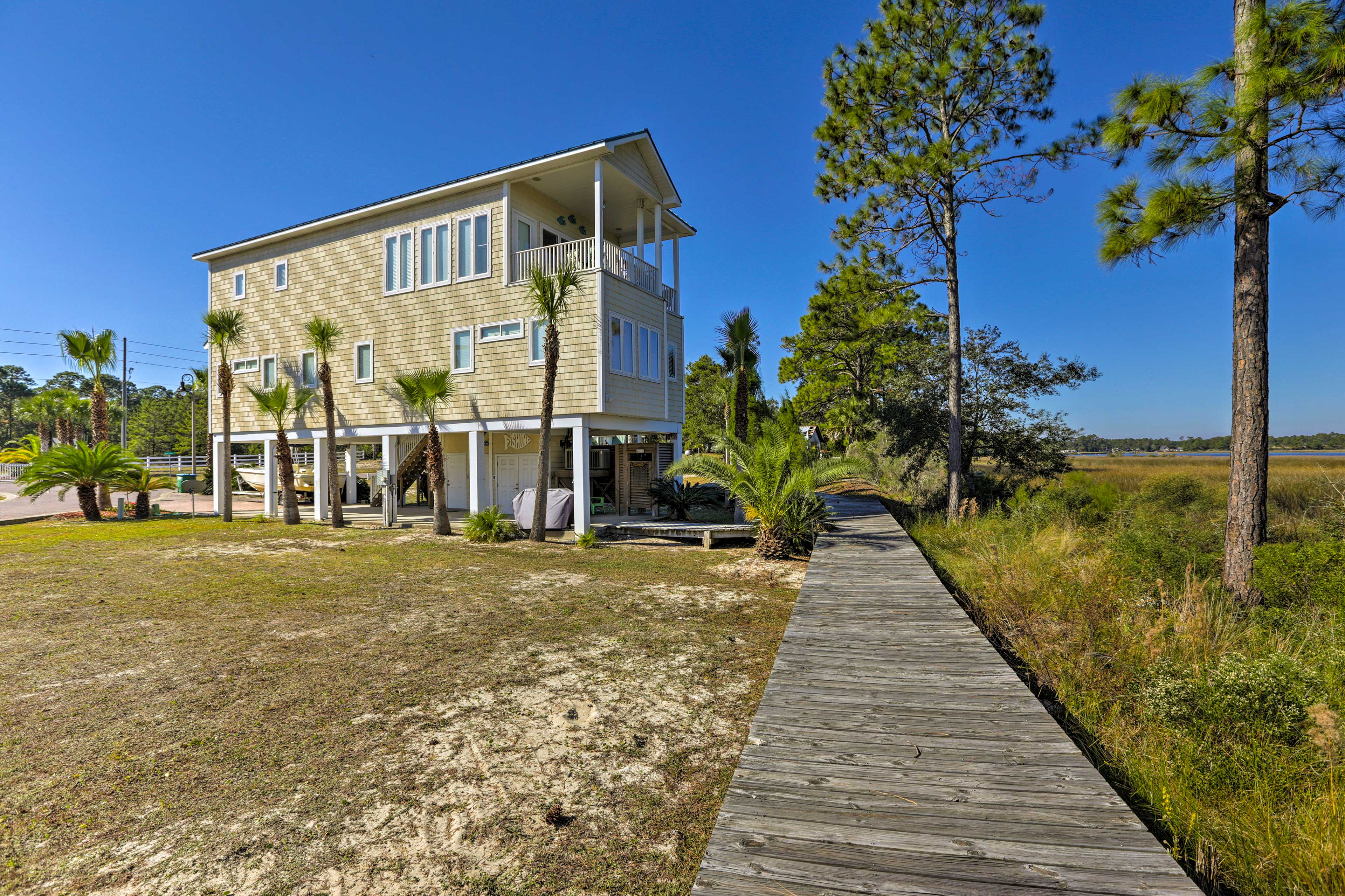 Situated on the Carrabelle River, this waterfront home offers a private dock.