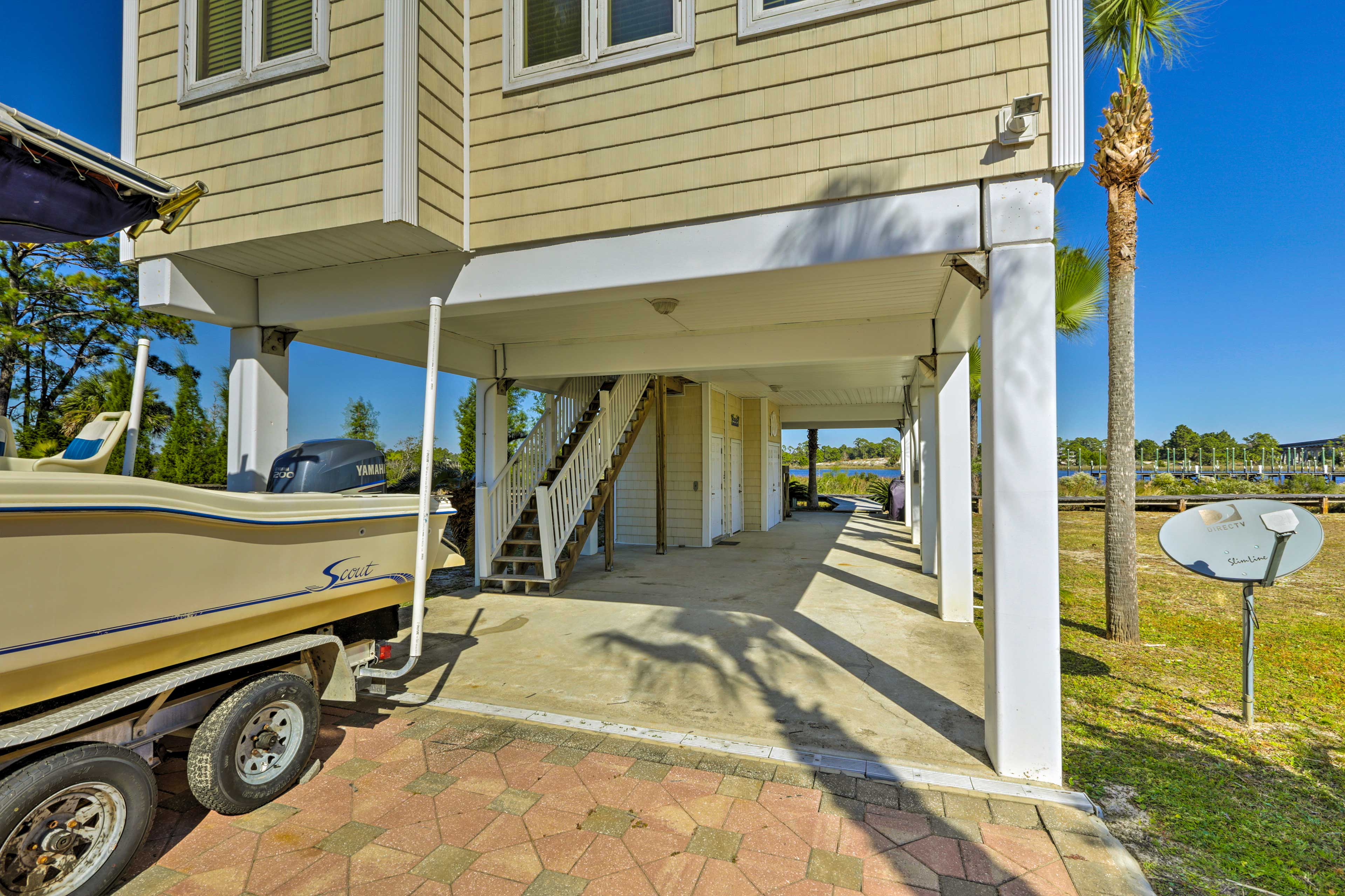 2 cars can be parked in the carport, while 2 additional cars can be parked in the driveway.