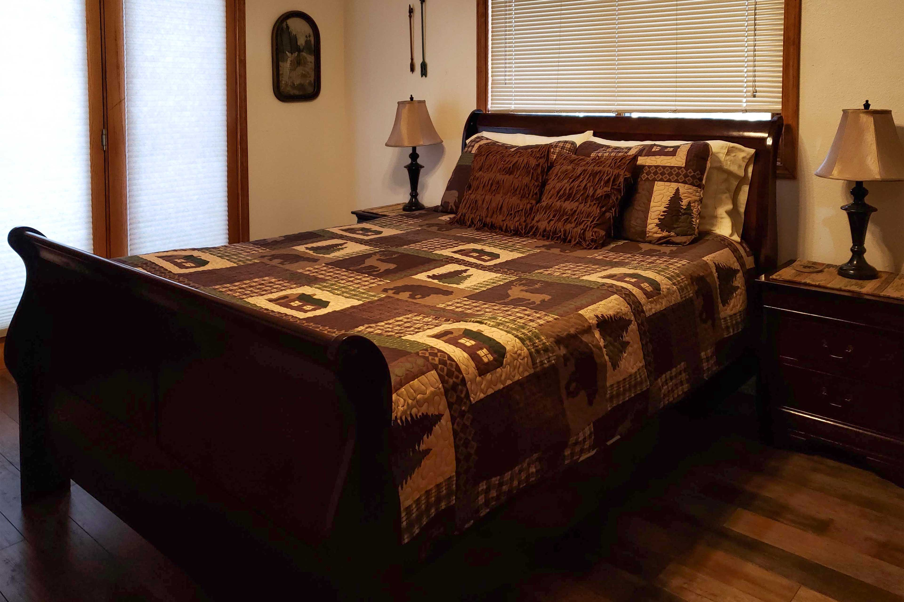 The fourth bedroom houses a queen-sized bed.