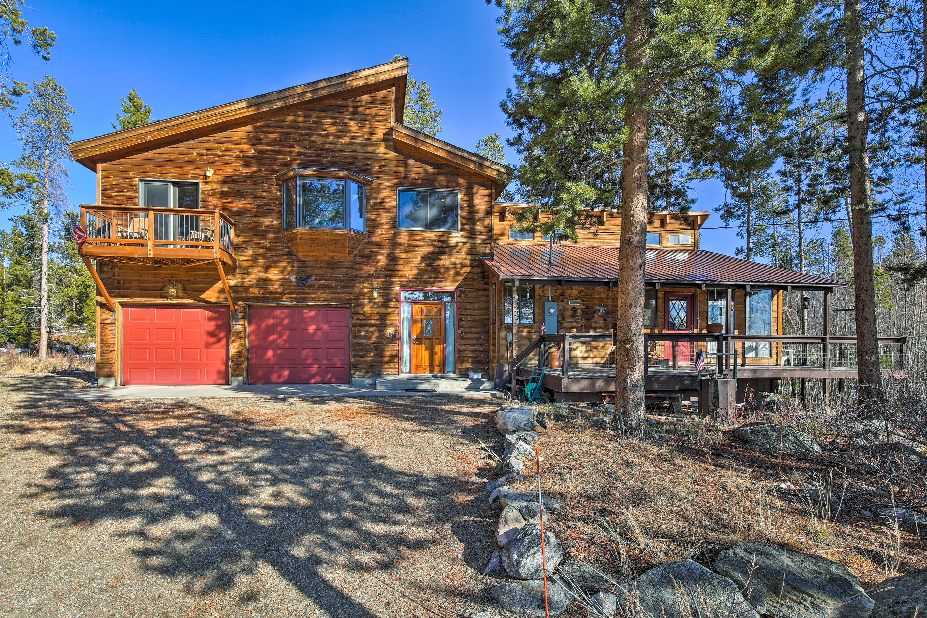 Situated on a 1-acre lot surrounded by pine trees, this home is an outdoor oasis