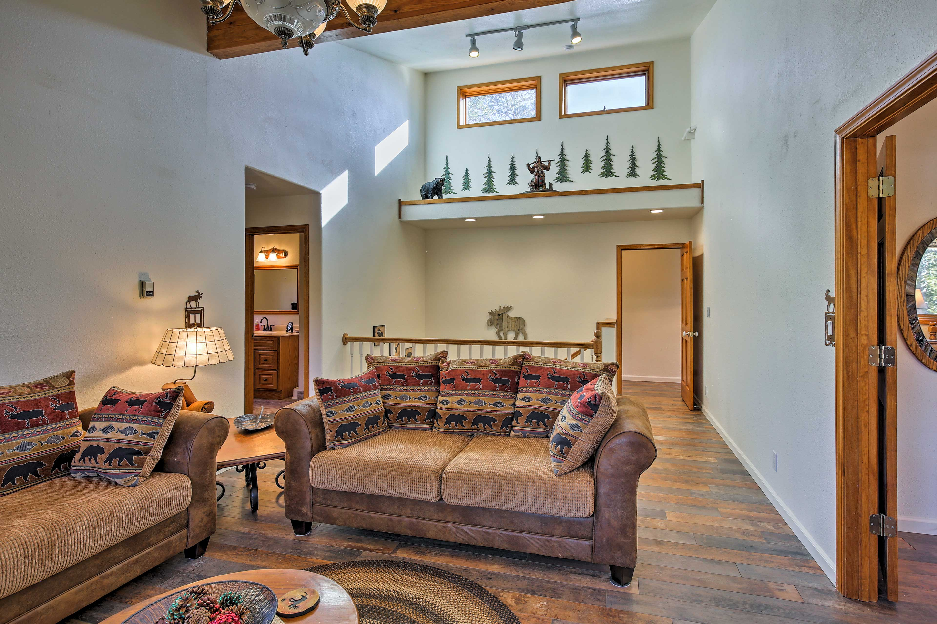 High ceilings and mountain-themed decor adorn the upstairs living space.