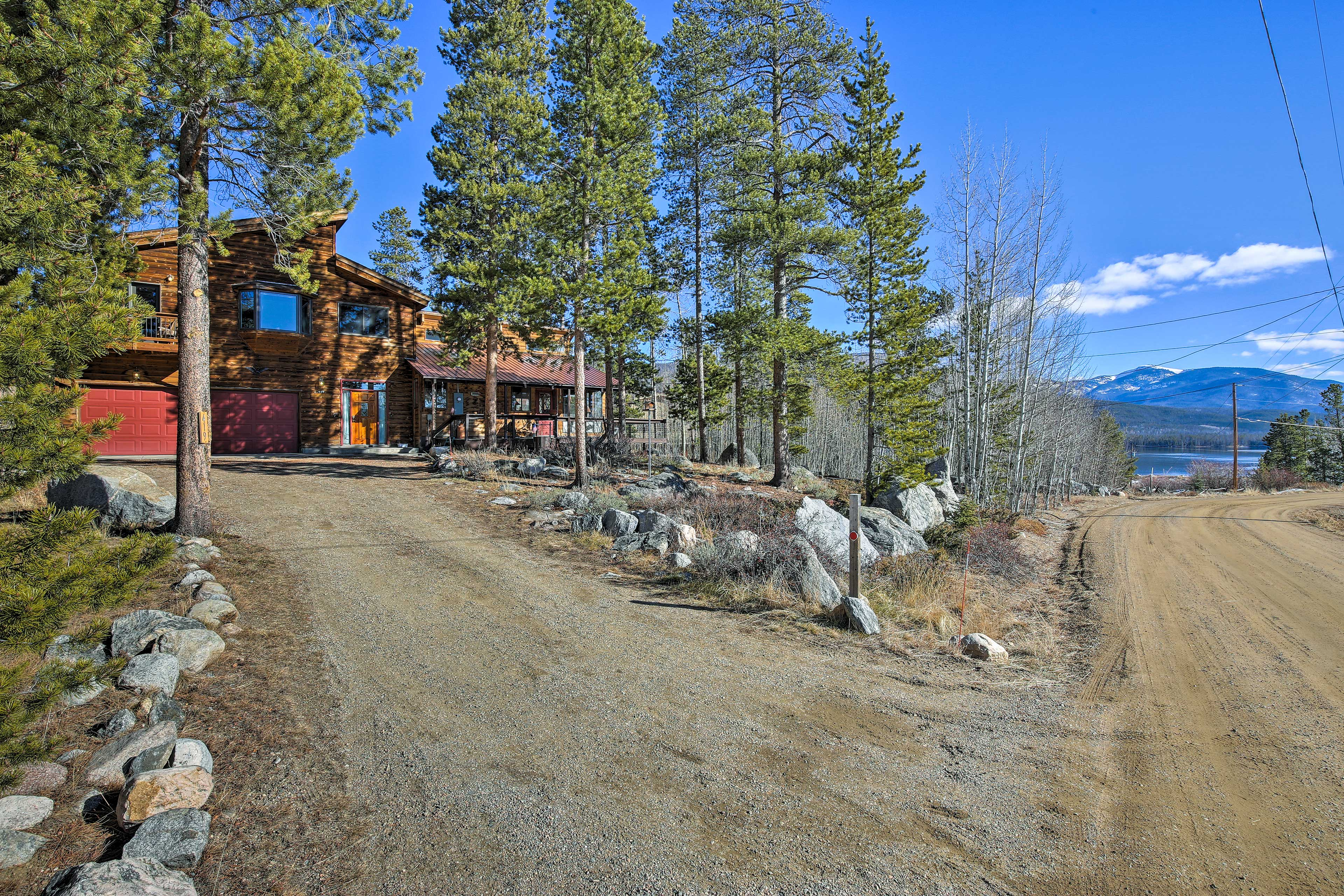 The large driveway provides parking for a boat, ATV or snowmobile trailer.