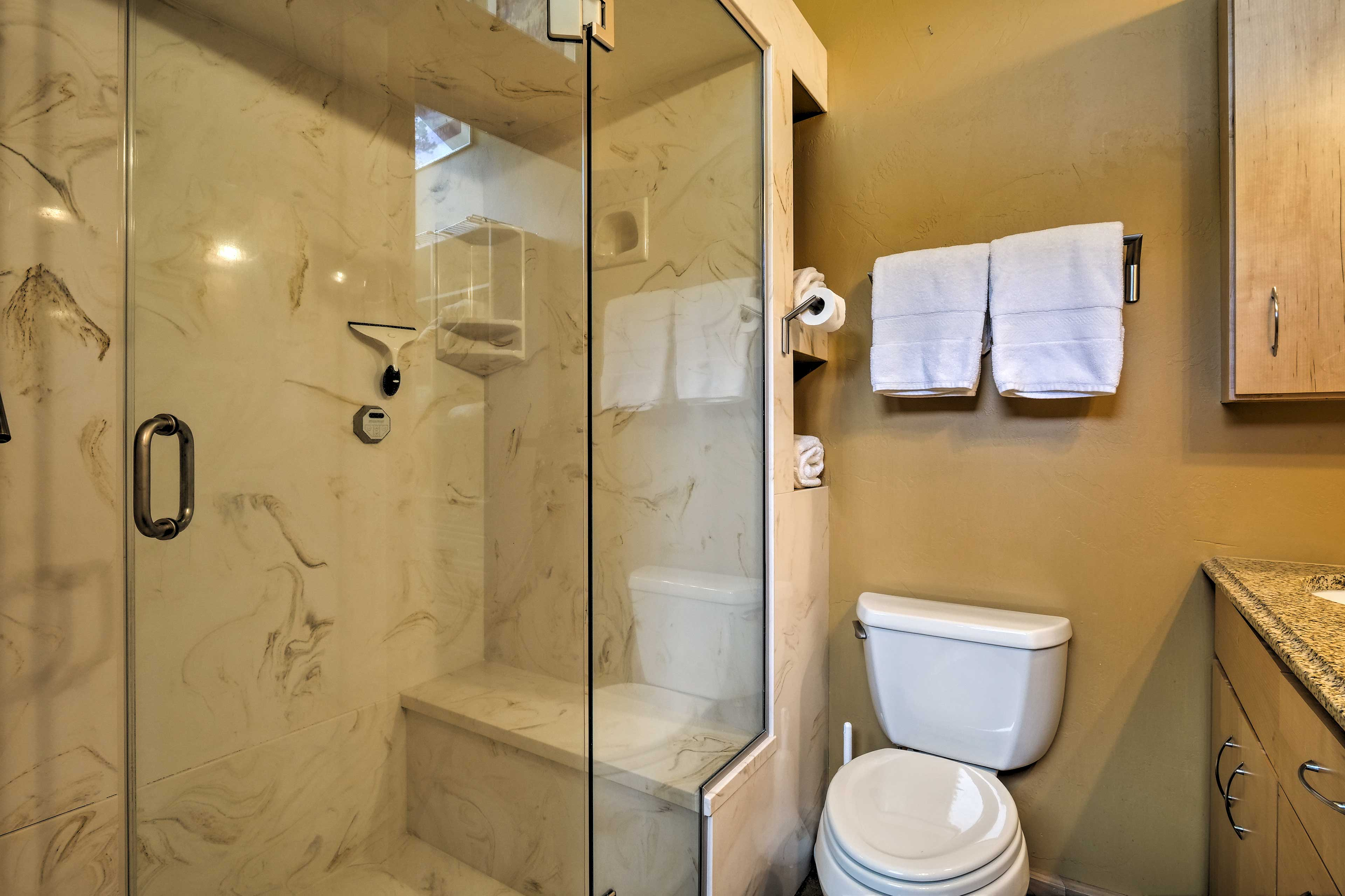 A second full bathroom is stocked with fresh towels.