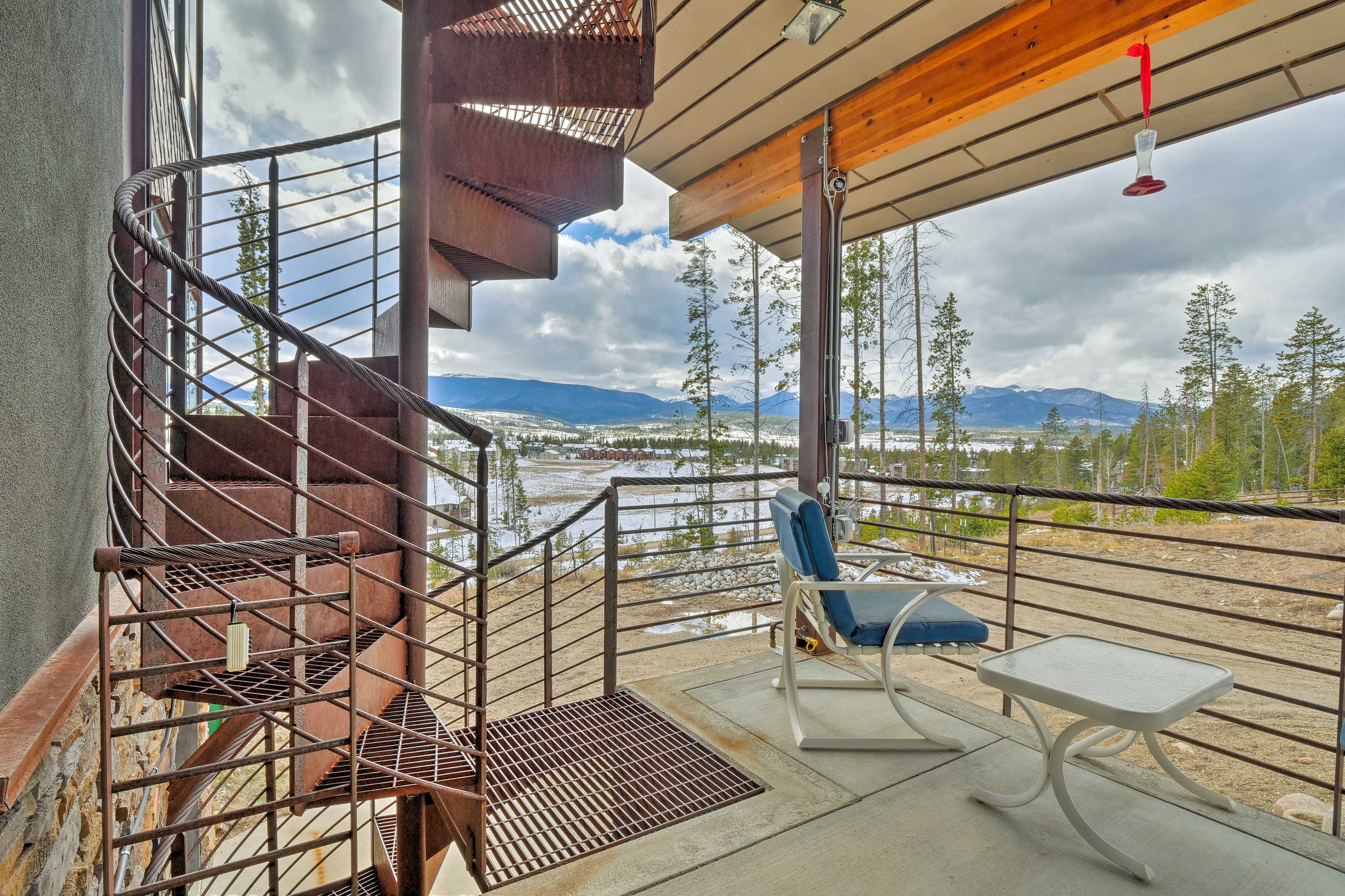 Head up the spiral staircase to access the home's second floor.