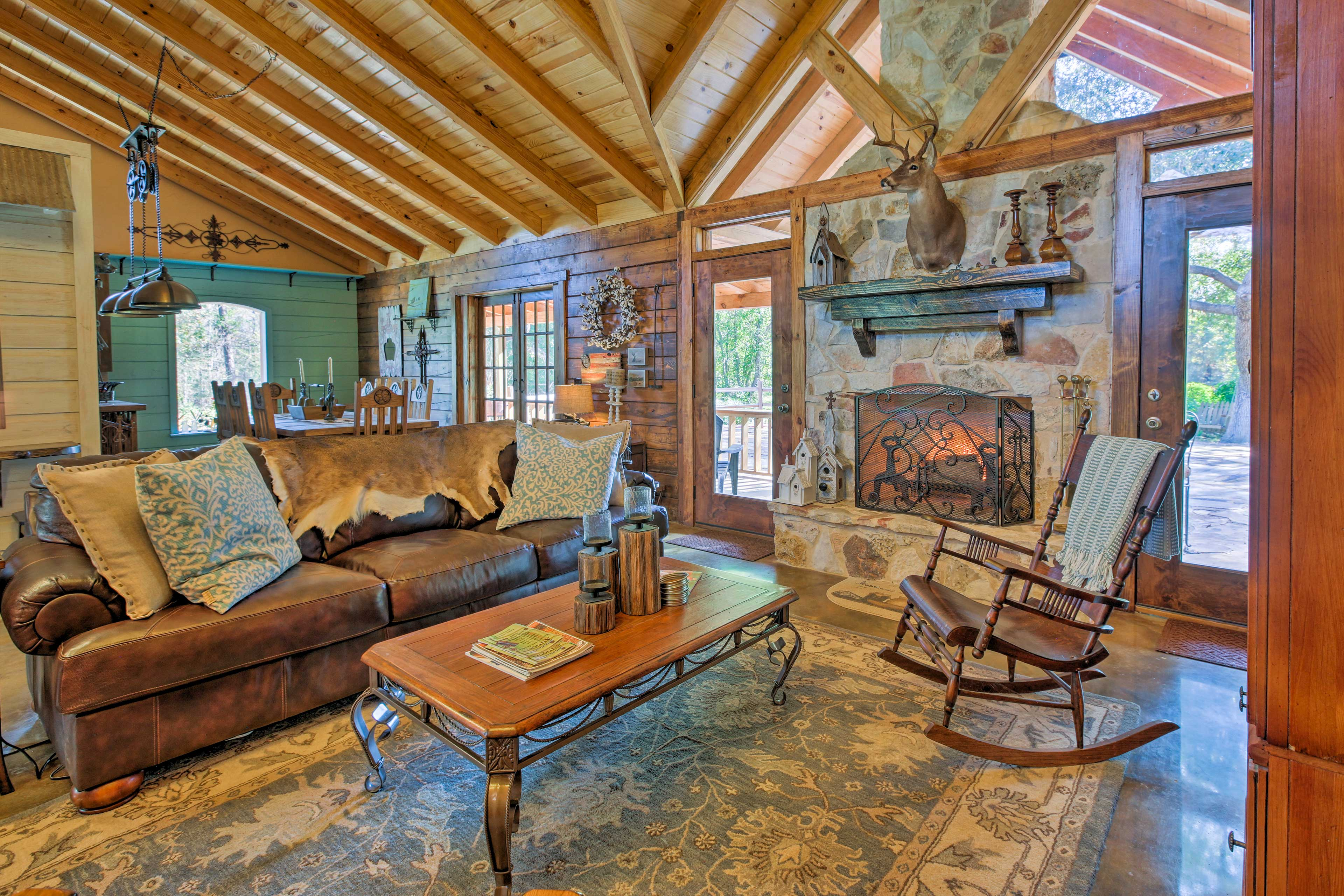 Make yourself at home on the plush sofas in the earthy living room.