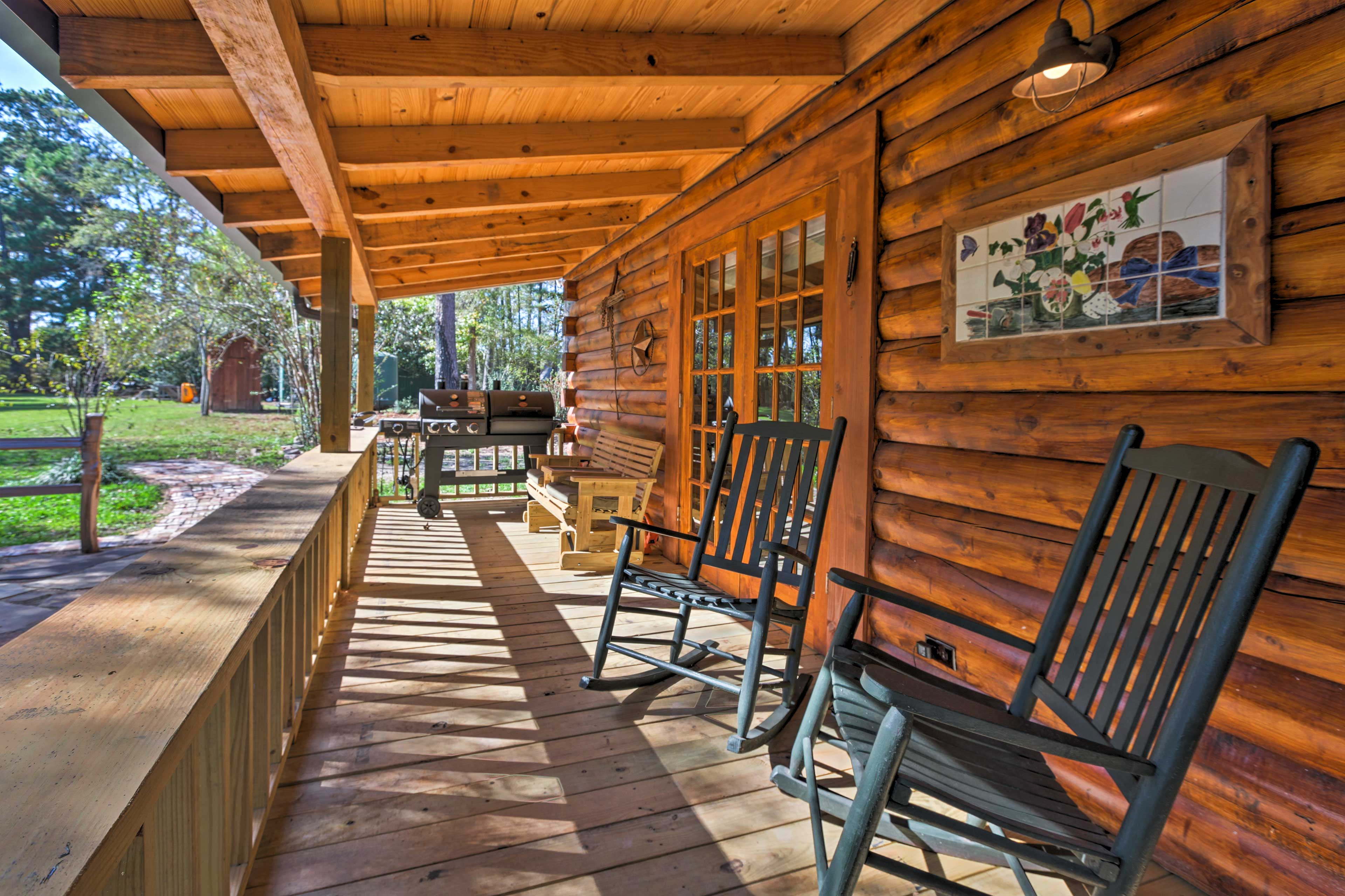 Relax in a rocking chair on the spacious back porch with views of the pond!