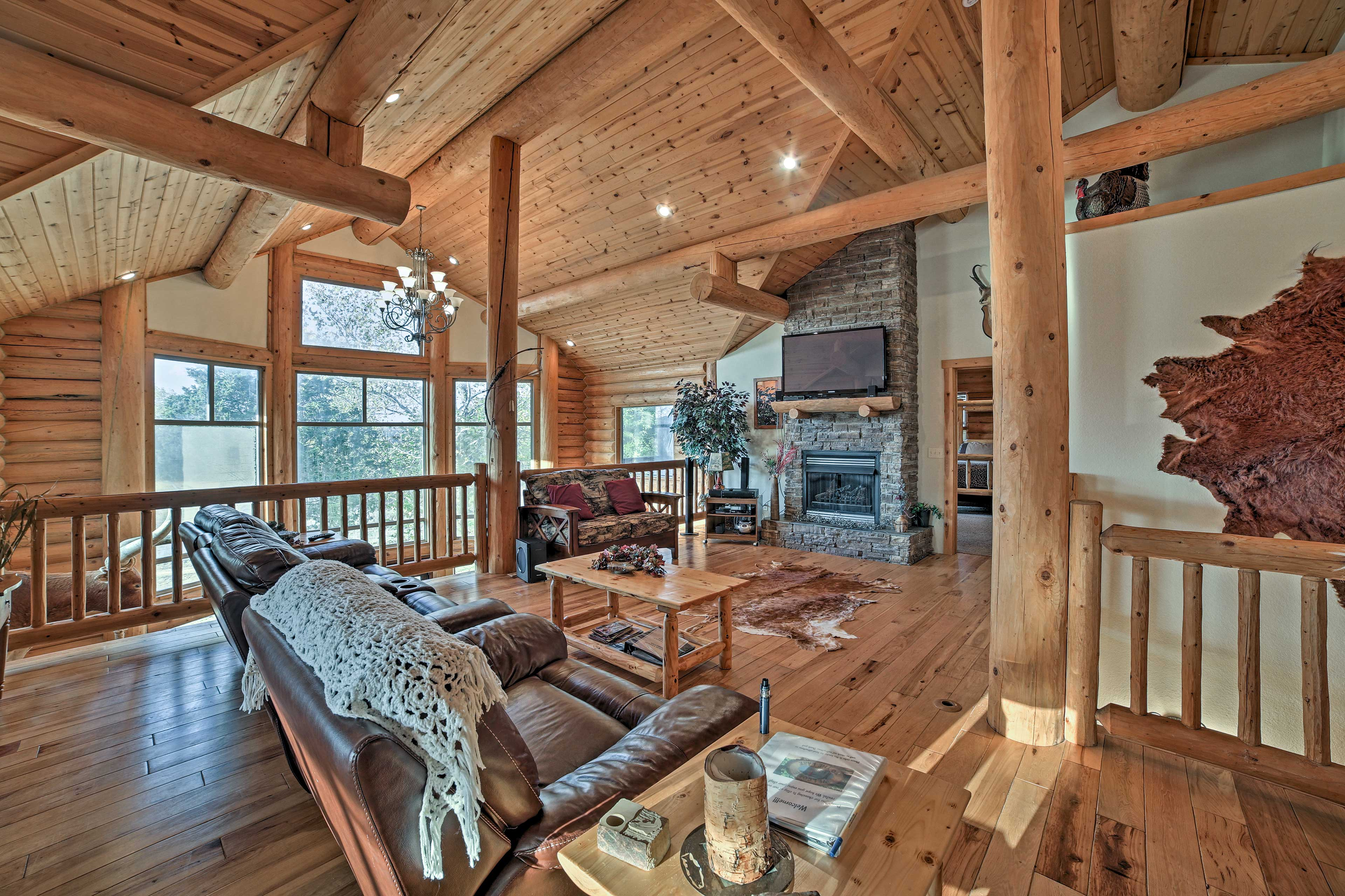 This impressive 3,200-square-foot log cabin boasts accommodations for 12.