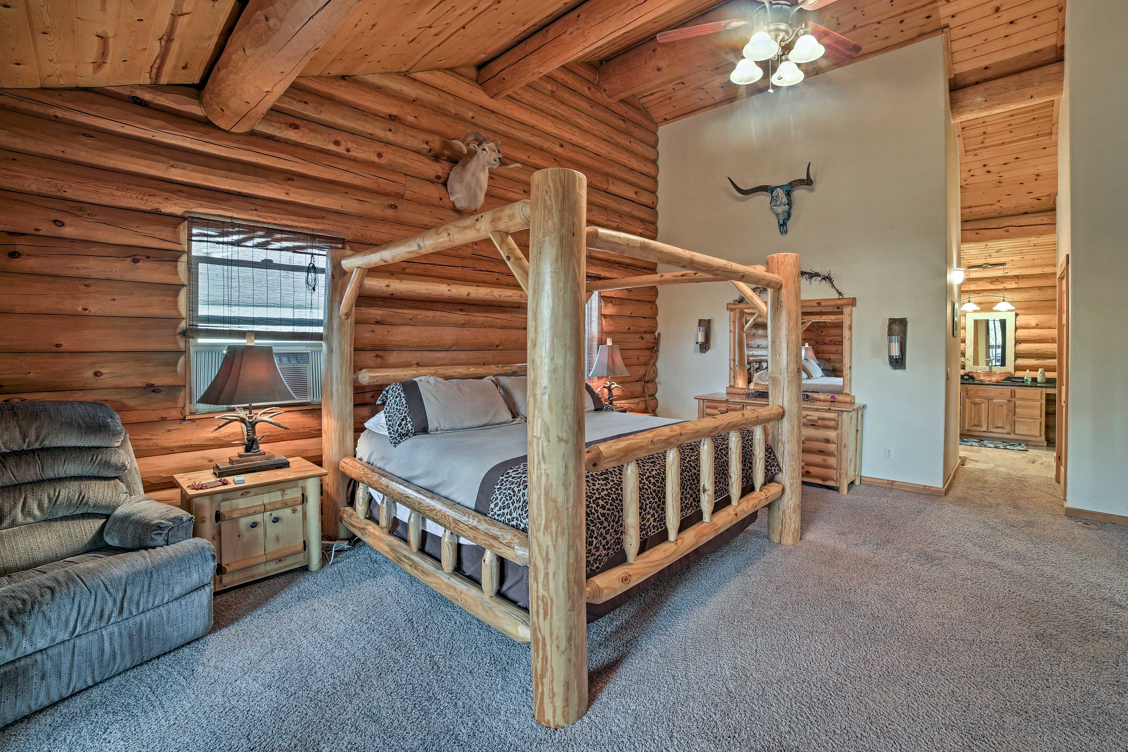 The stunning master includes a king-sized bed.
