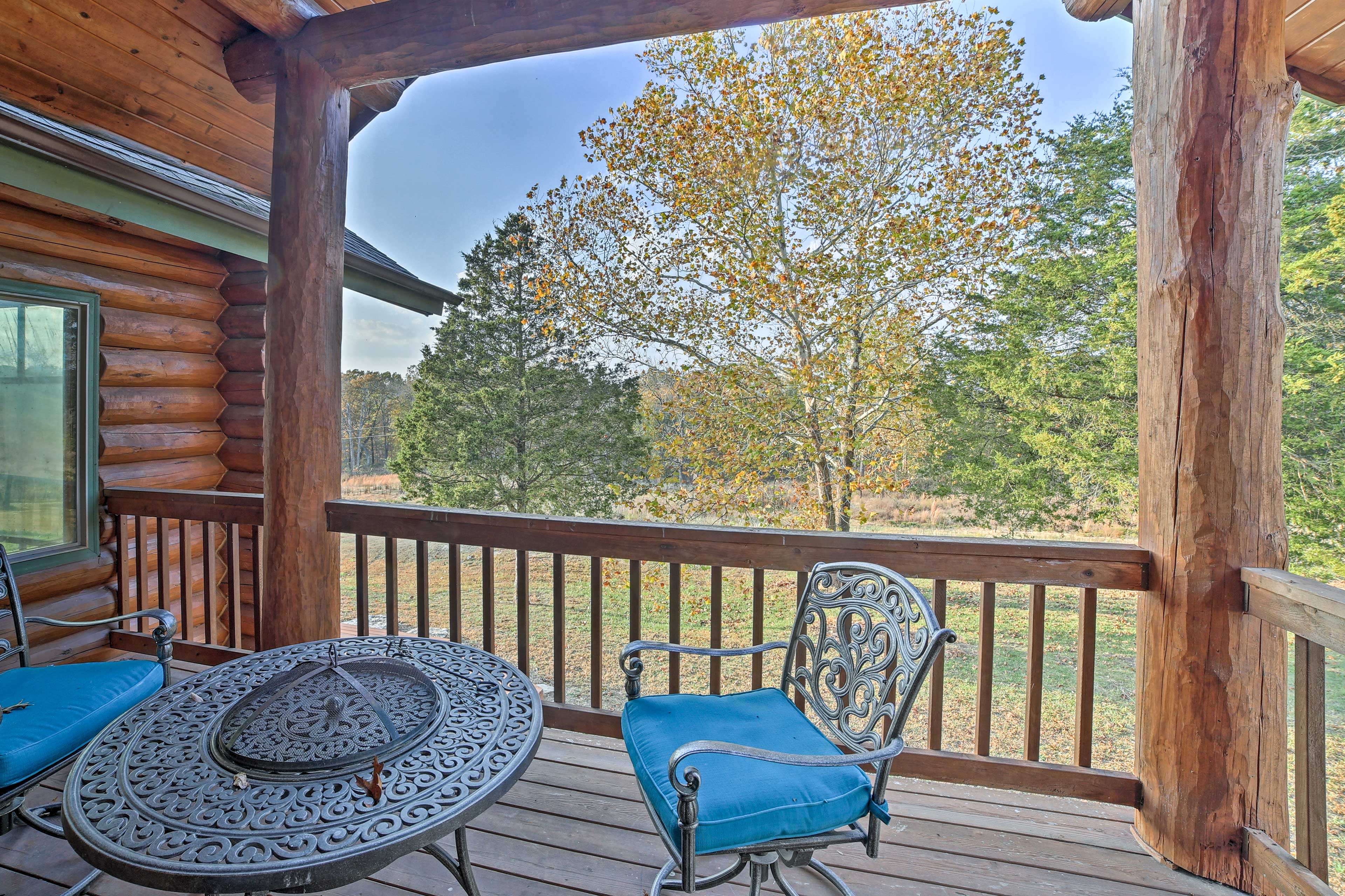 Step out onto the master suite balcony to find a table fire pit.