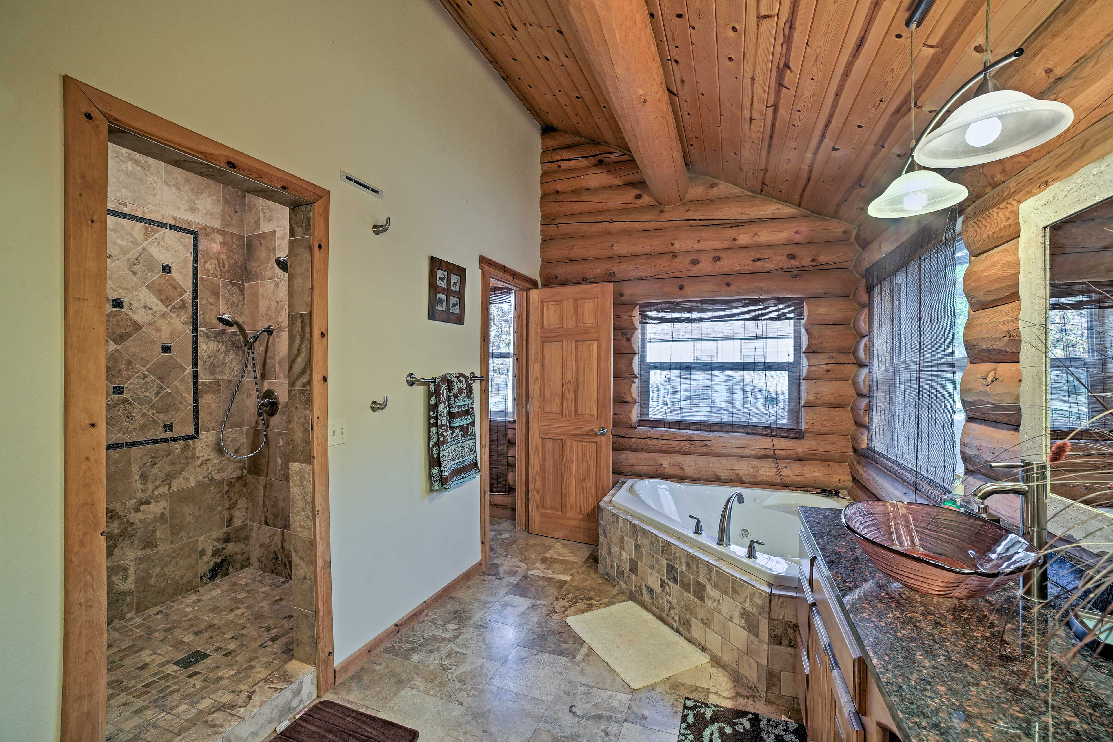 The en-suite master bath features double sinks, walk-in shower and soaking tub.