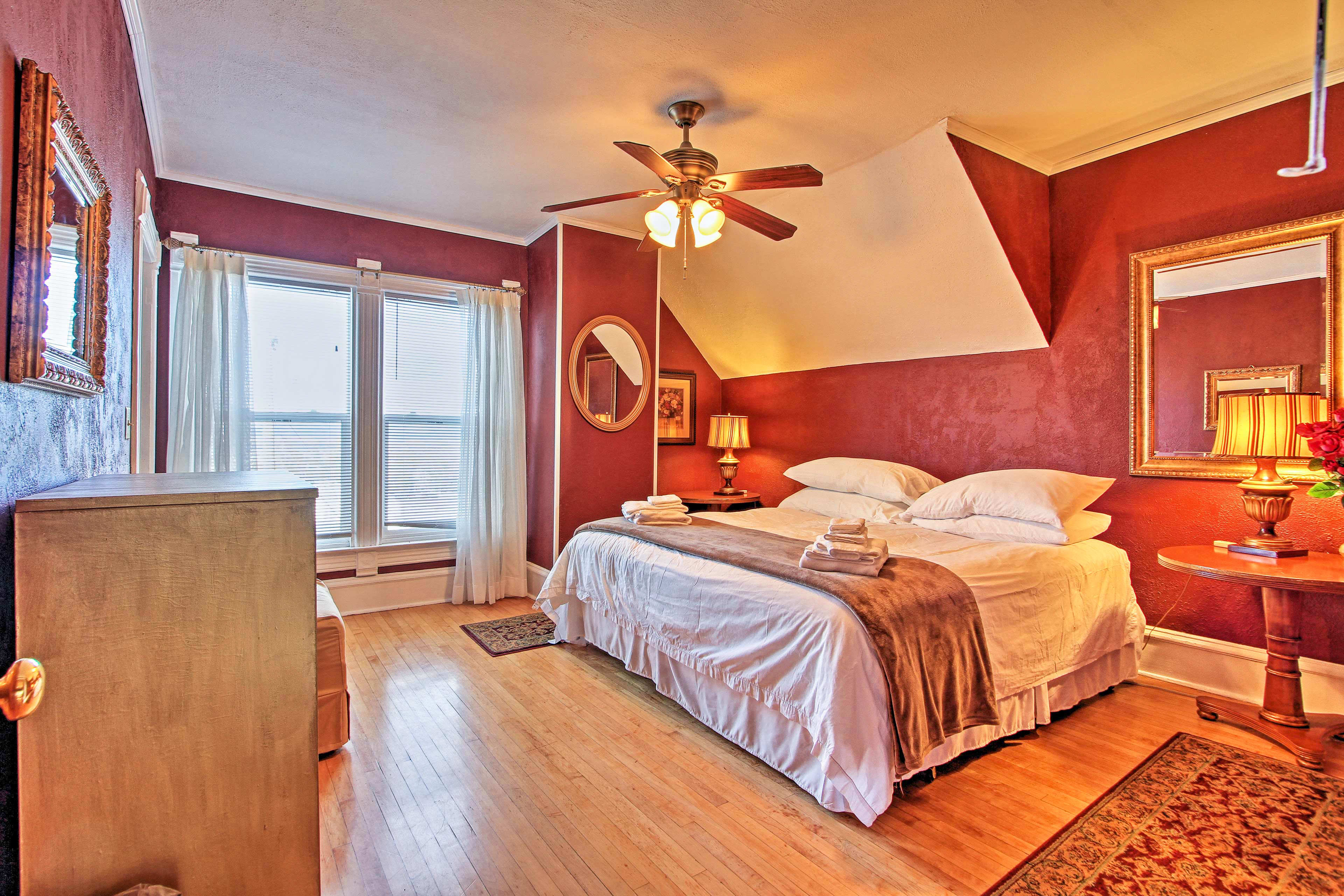 Enjoy beautiful mountain views out of this room's floor-to-ceiling windows.