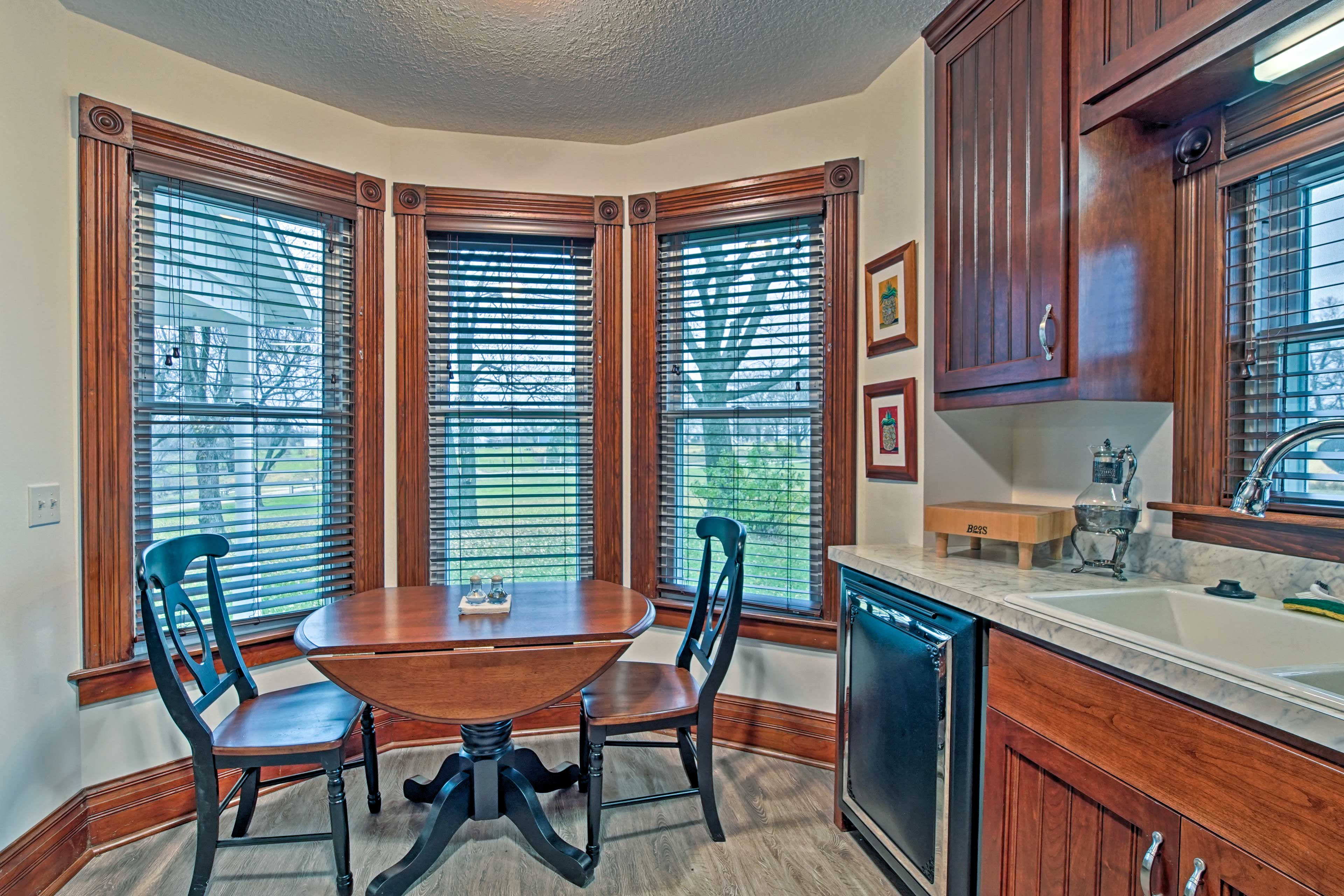 Enjoy coffee and cereal at the cozy breakfast table.