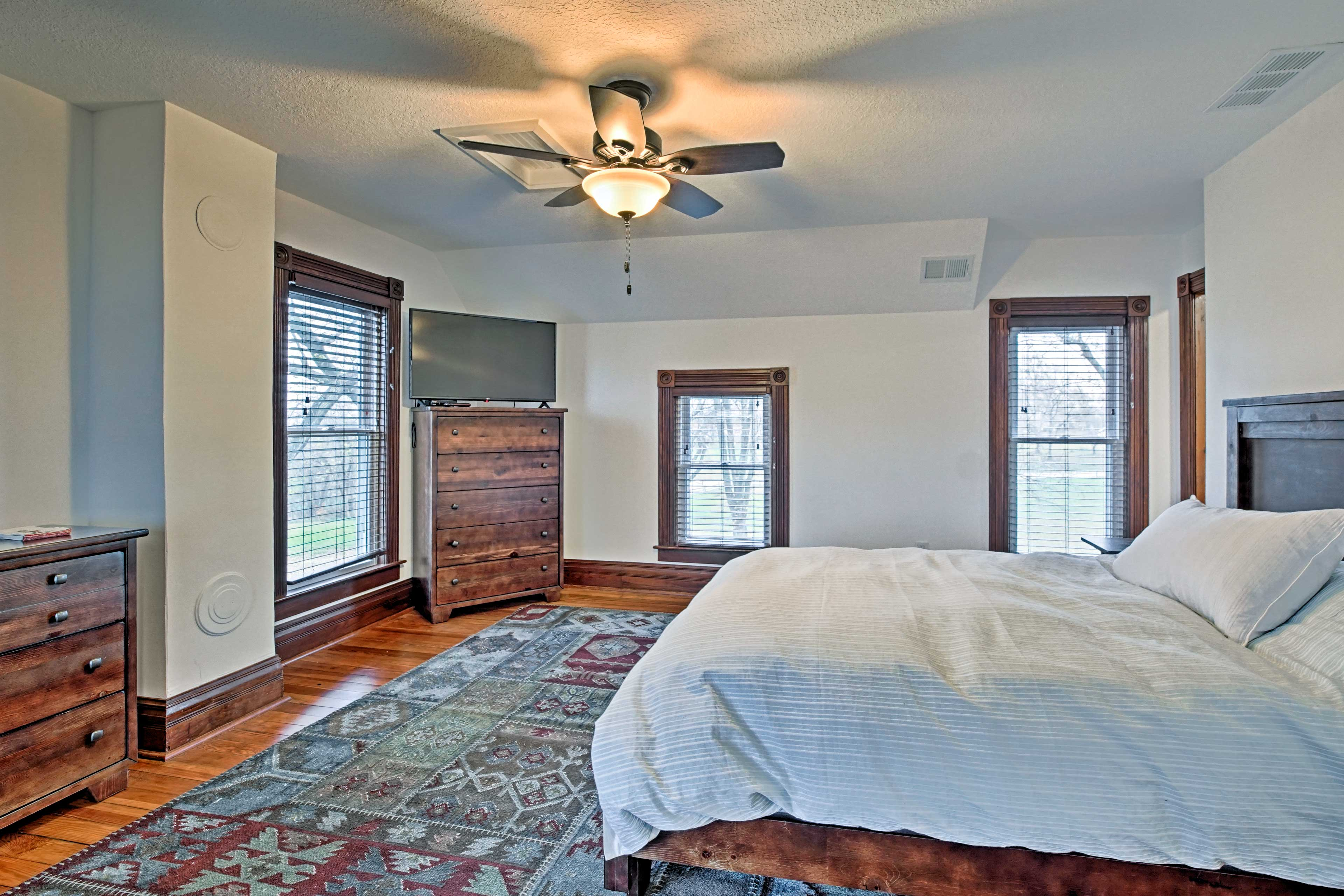 The master bedroom features a cozy queen bed and a flat-screen cable TV.