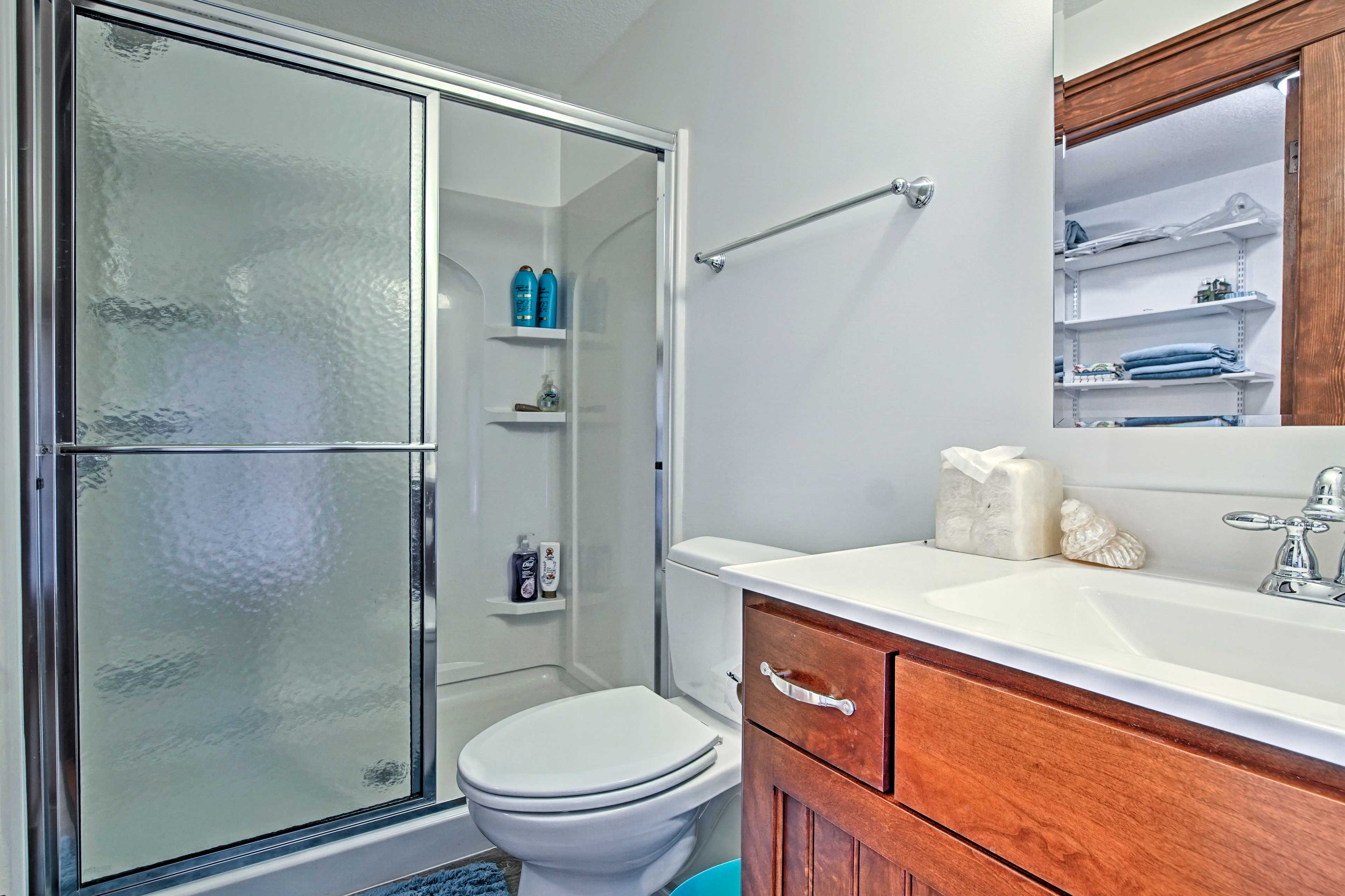This bathroom hosts a walk-in shower.