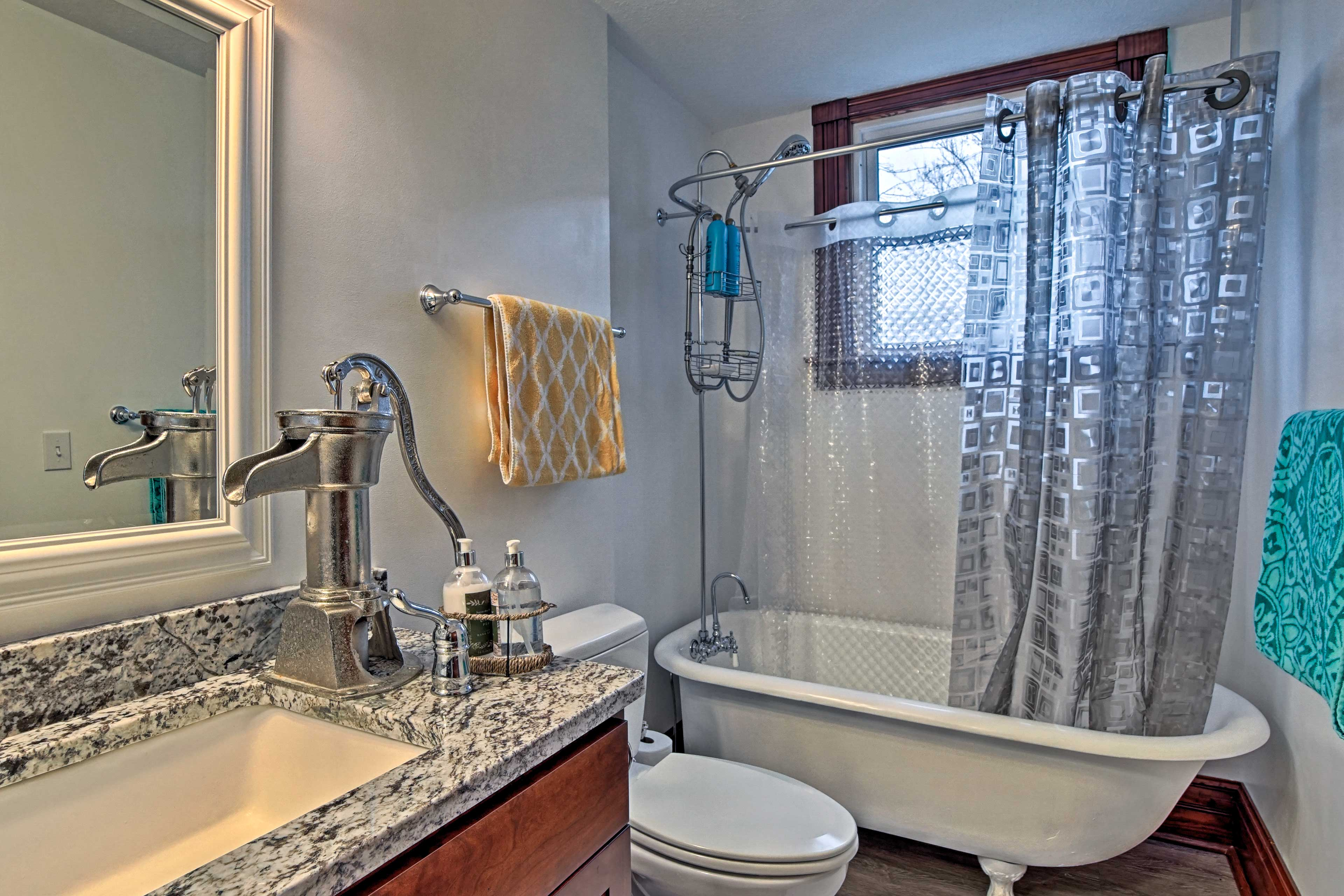 Soak in the claw-foot bathtub newly refurbished!