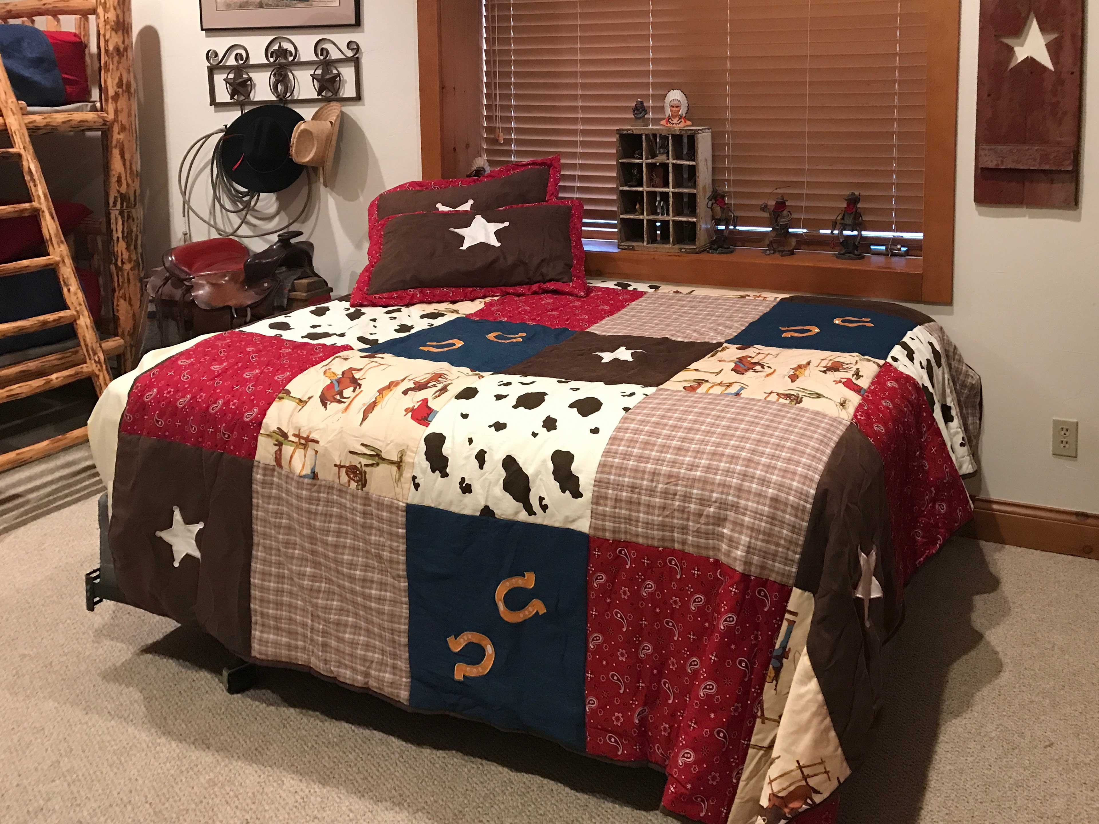 Two twin beds and a twin-over-twin bunk bed make this room excellent for kids.