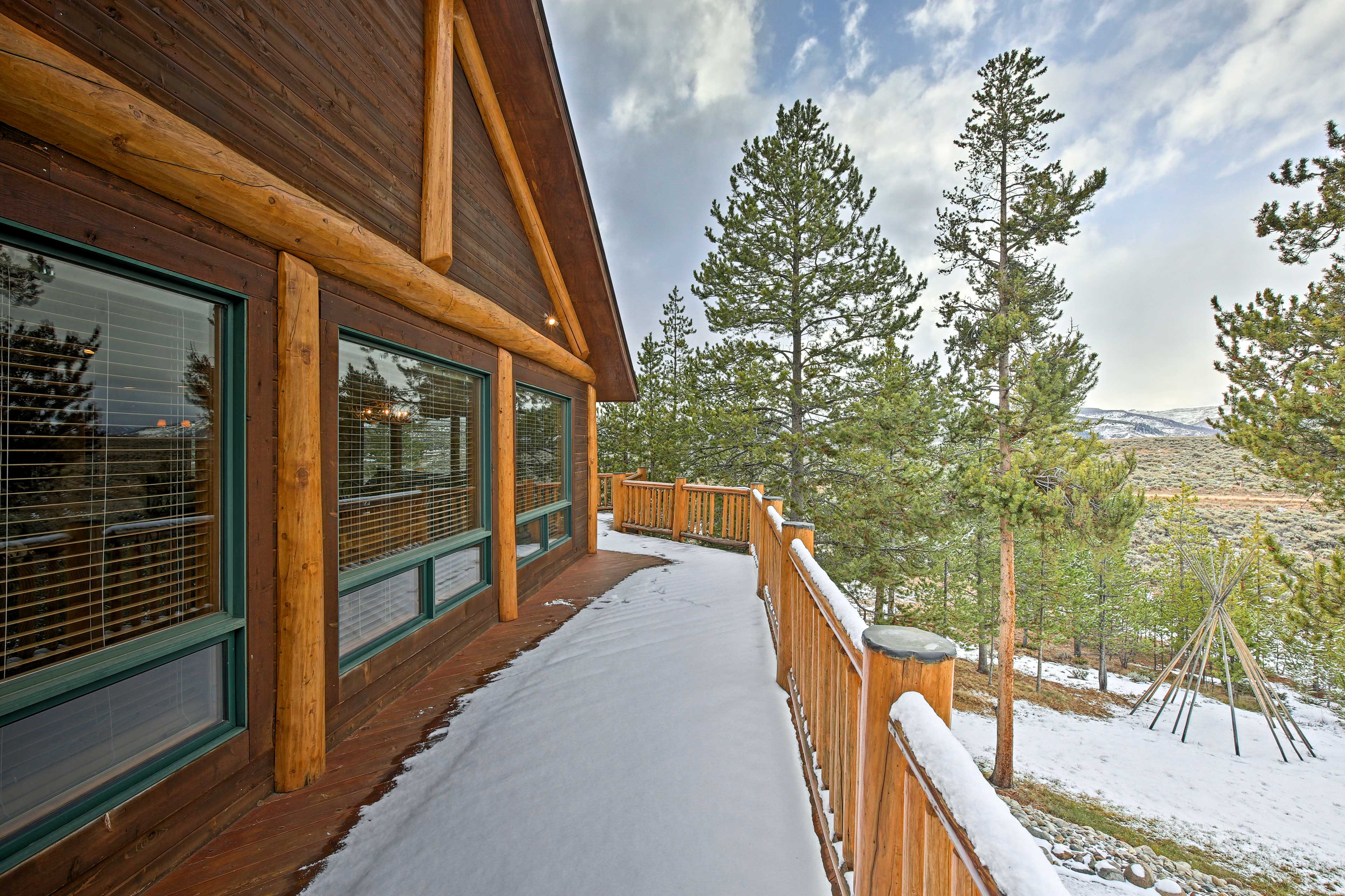 The property features a large deck with stunning unobstructed views.