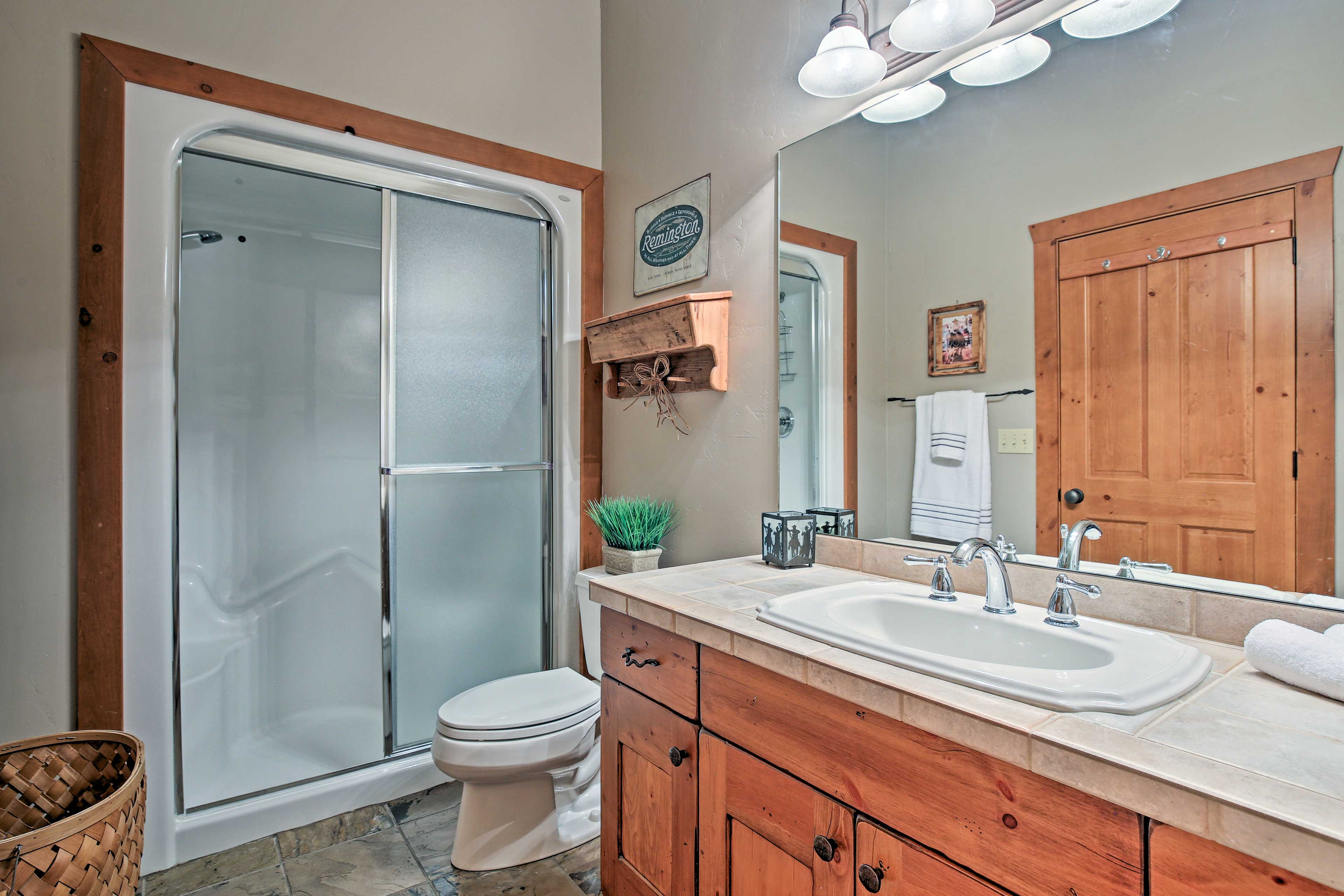 The downstairs bathroom features a luxurious steam shower!