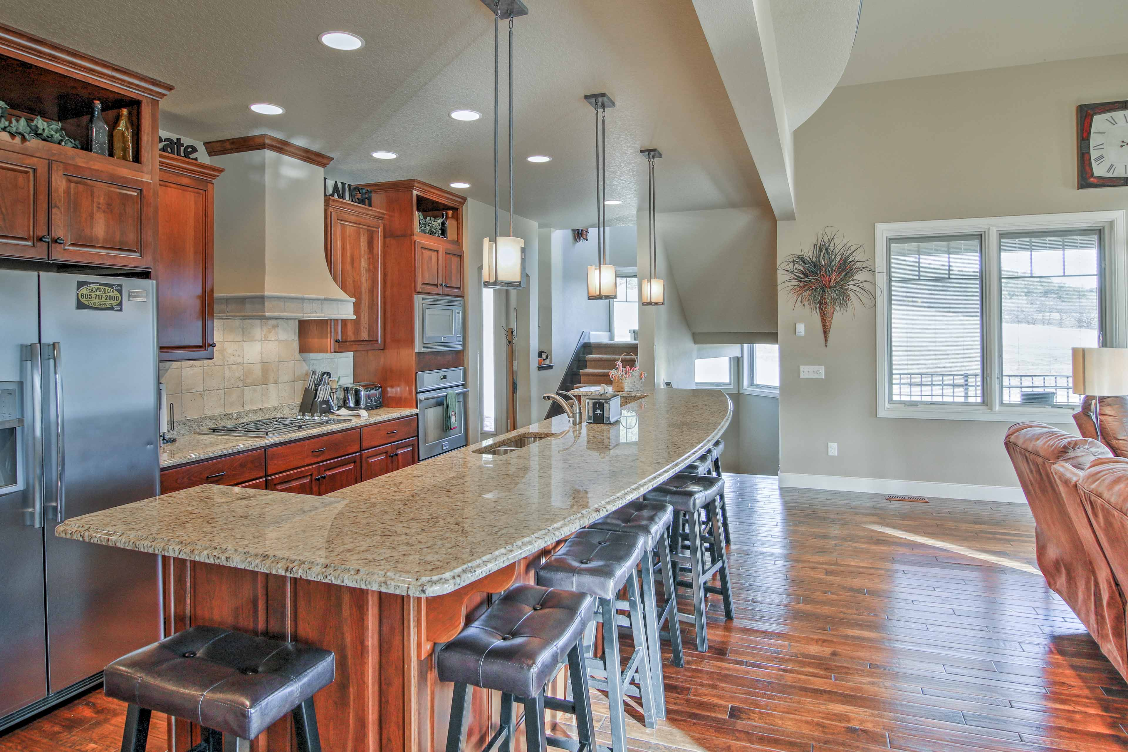 Grab a quick bite to eat at the 7-person bar seating around the kitchen island.