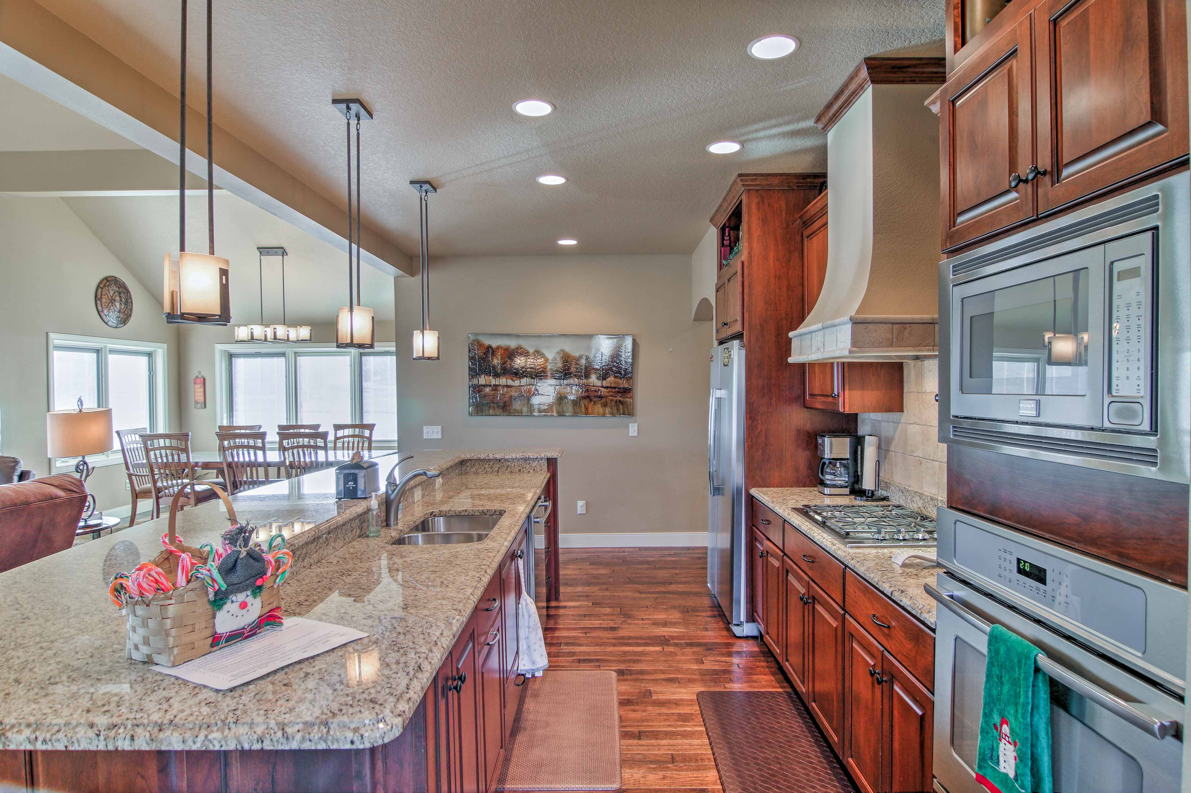 Stainless steel appliances and ample granite countertops highlight the kitchen.