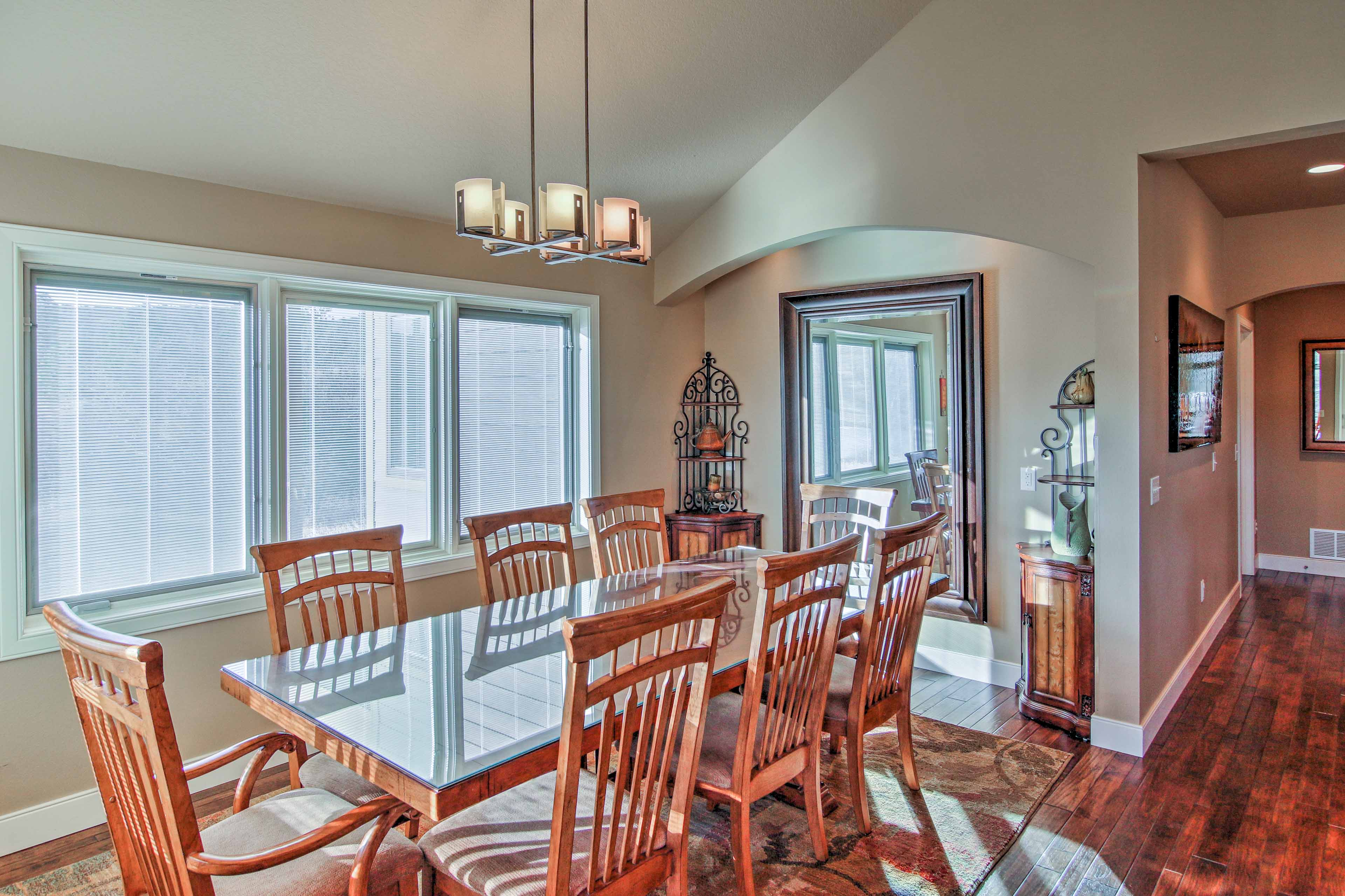 Gather around the 8-person dining table to enjoy a home-cooked meal.