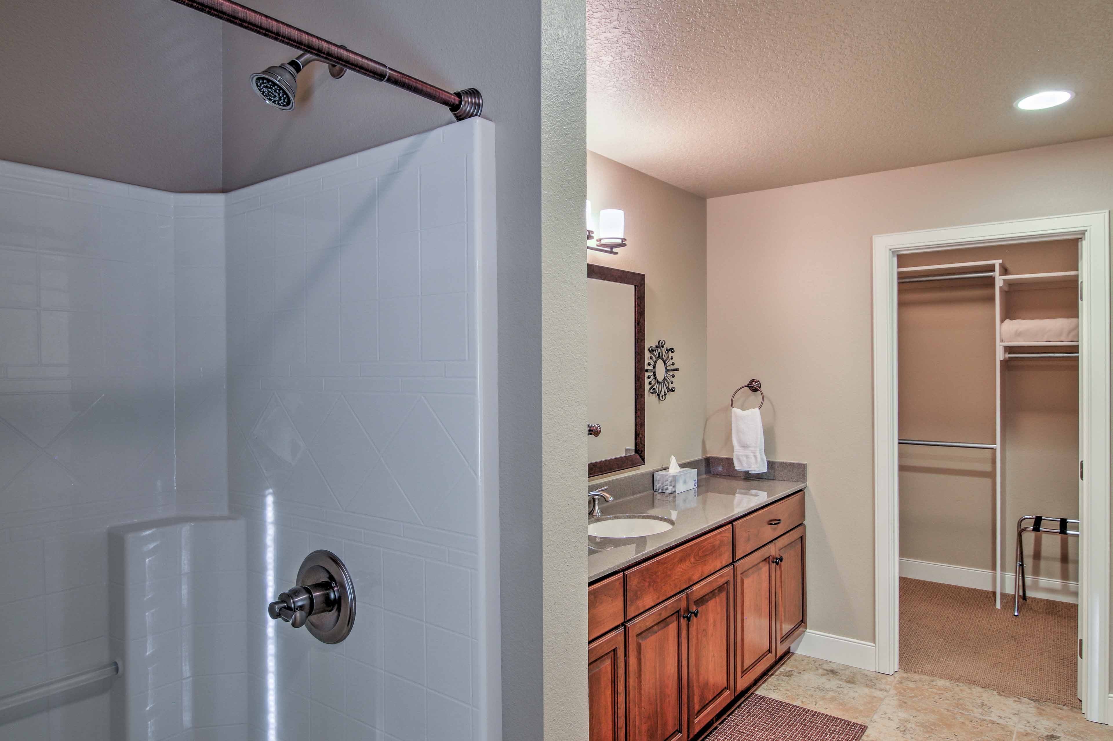 Utilize the walk-in shower and large vanity featured in the second bathroom.