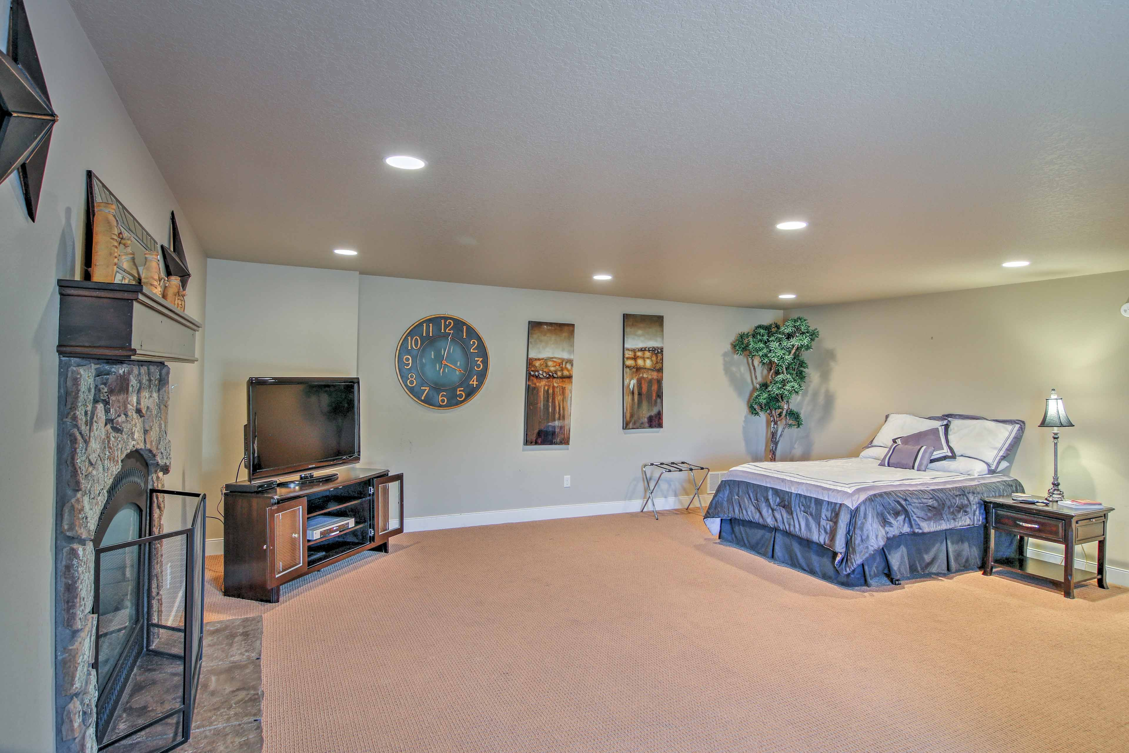 The basement bedroom includes a flat-screen cable TV and gas fireplace.