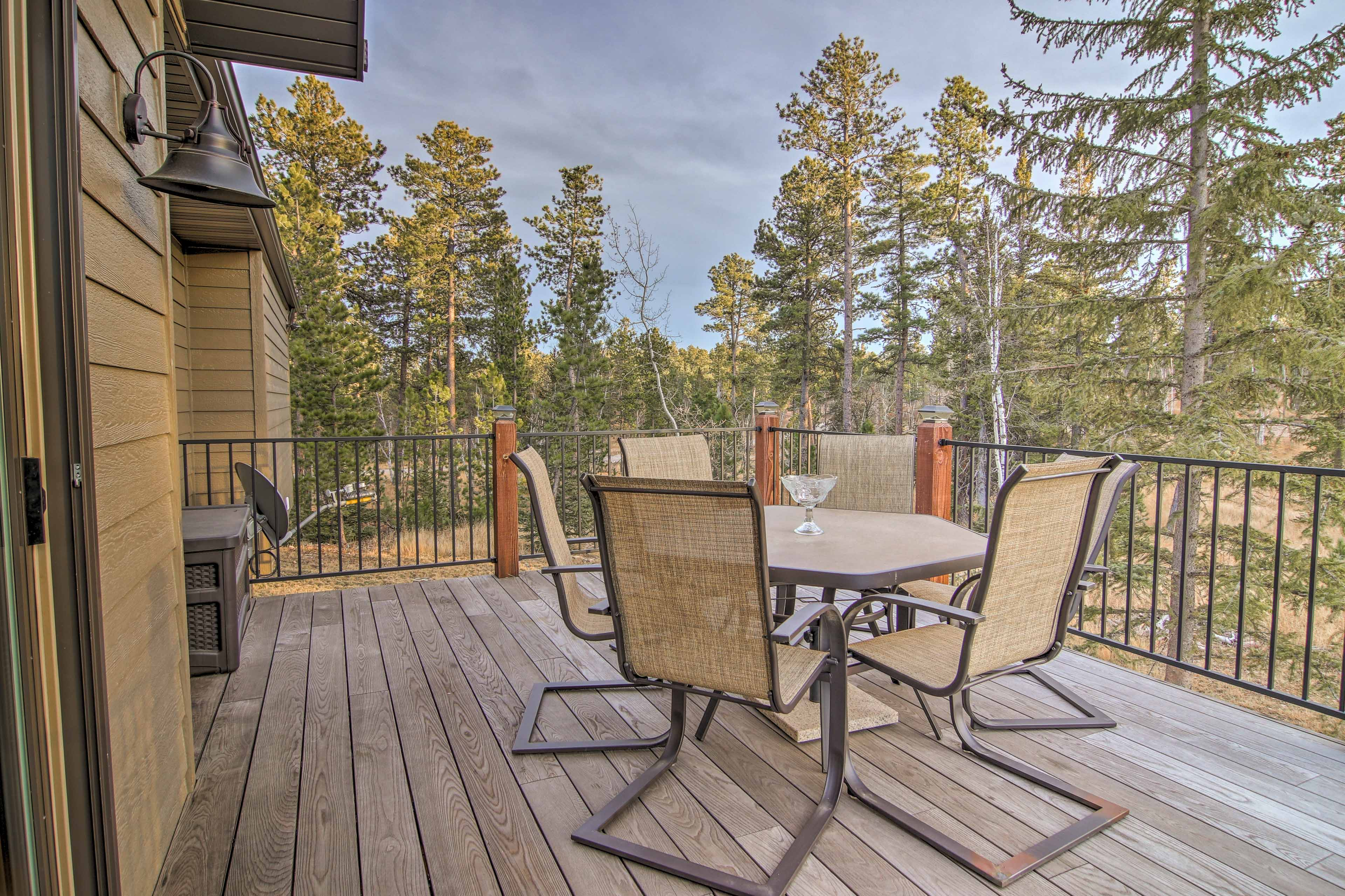 Nestled away under towering pines, this home feels secluded, yet only minutes from town!