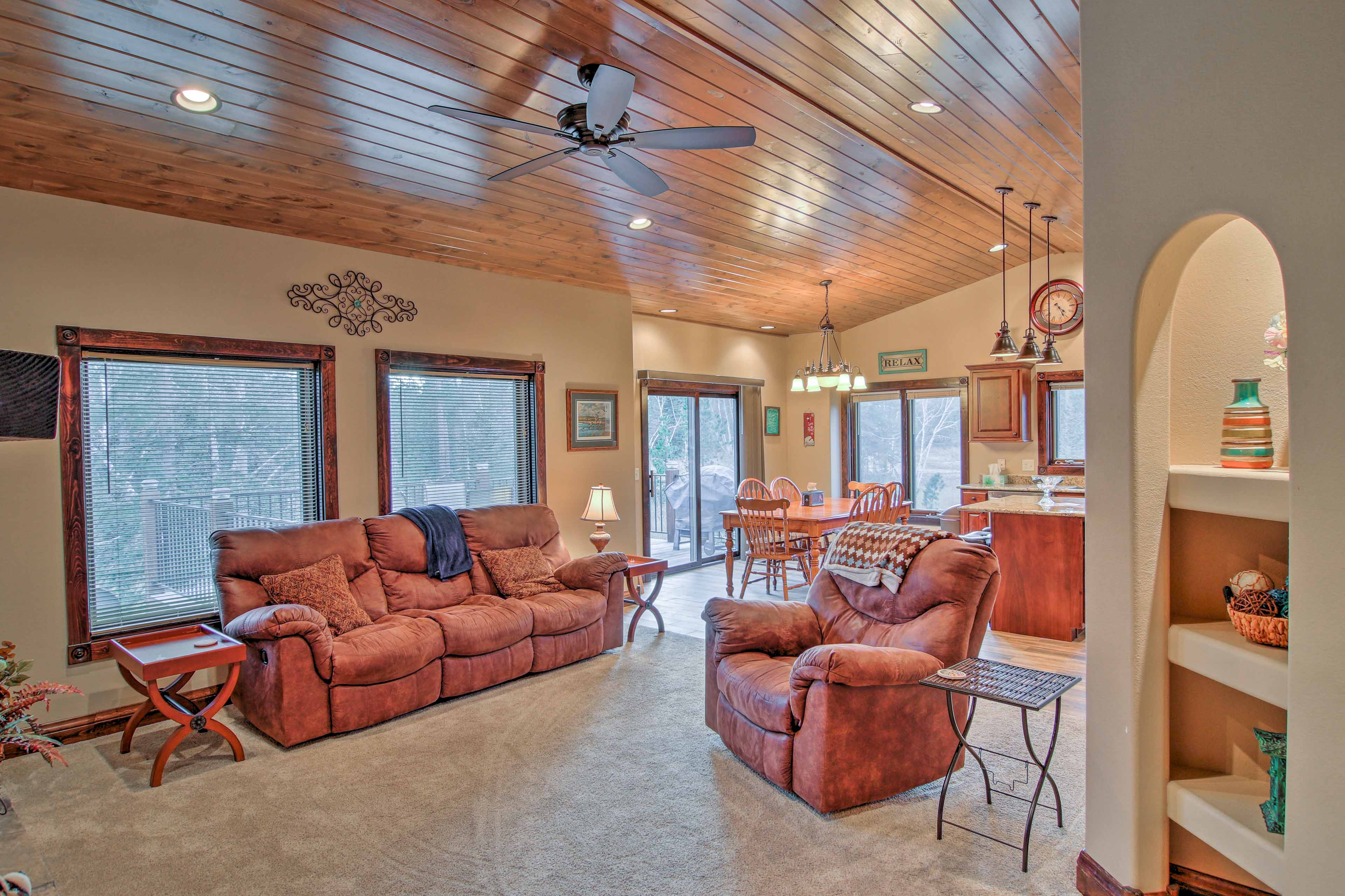 High ceilings and large windows make the open-concept floor plan feel even more inviting.