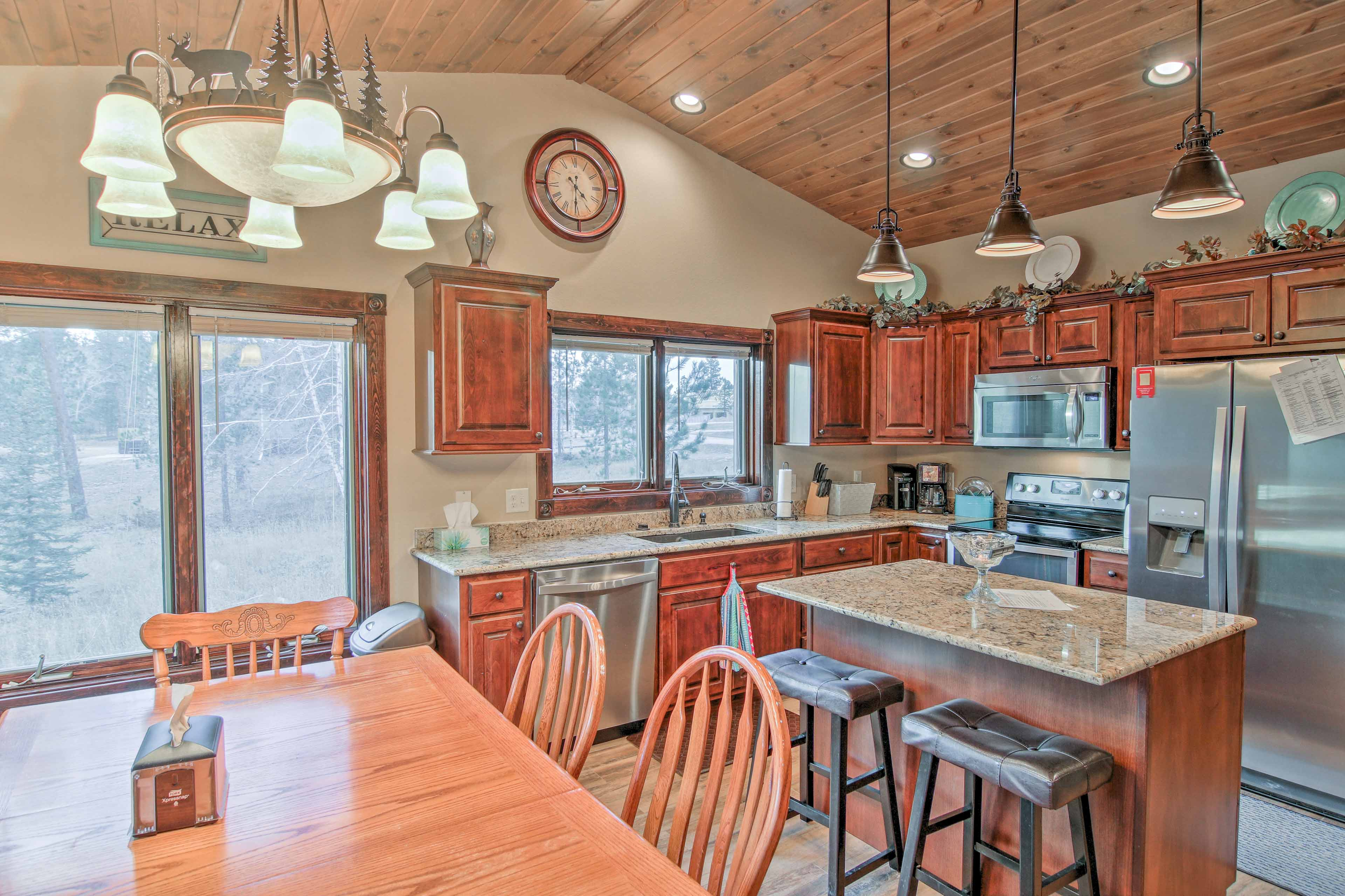 The kitchen is fully equipped with stainless steel appliances & granite!