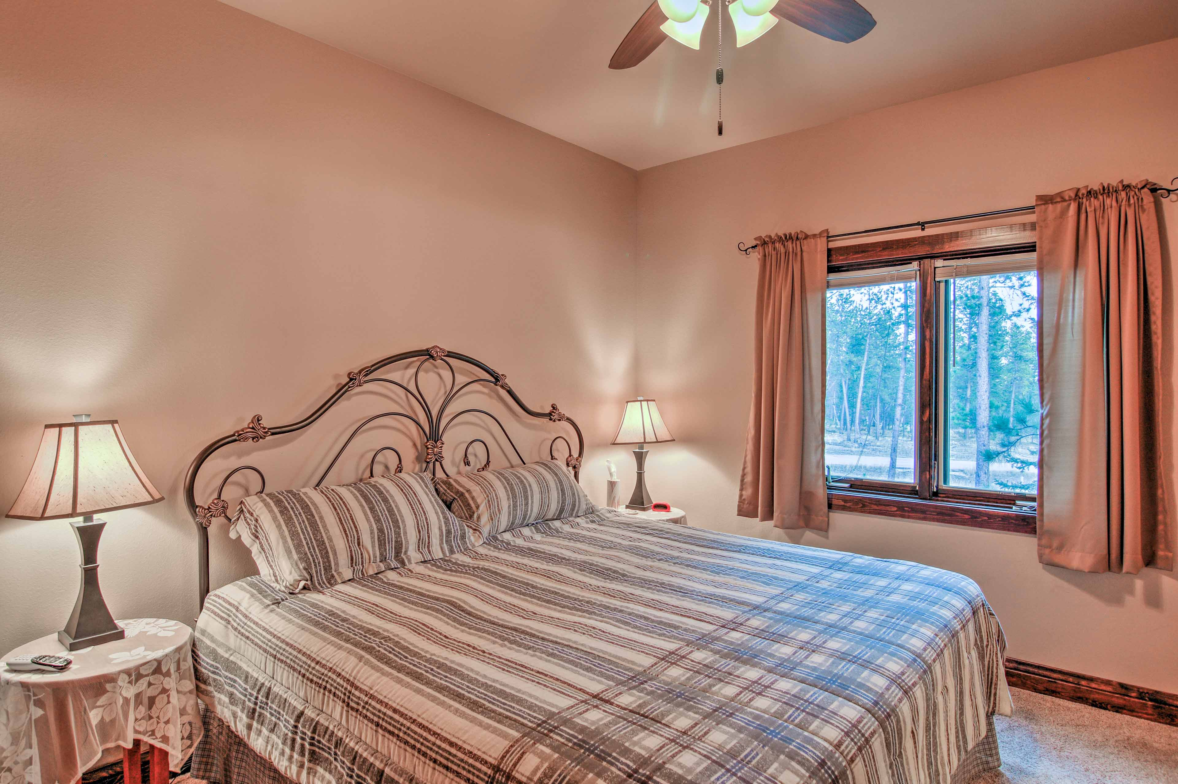 Take in some R&R on the king bed in the master bedroom.