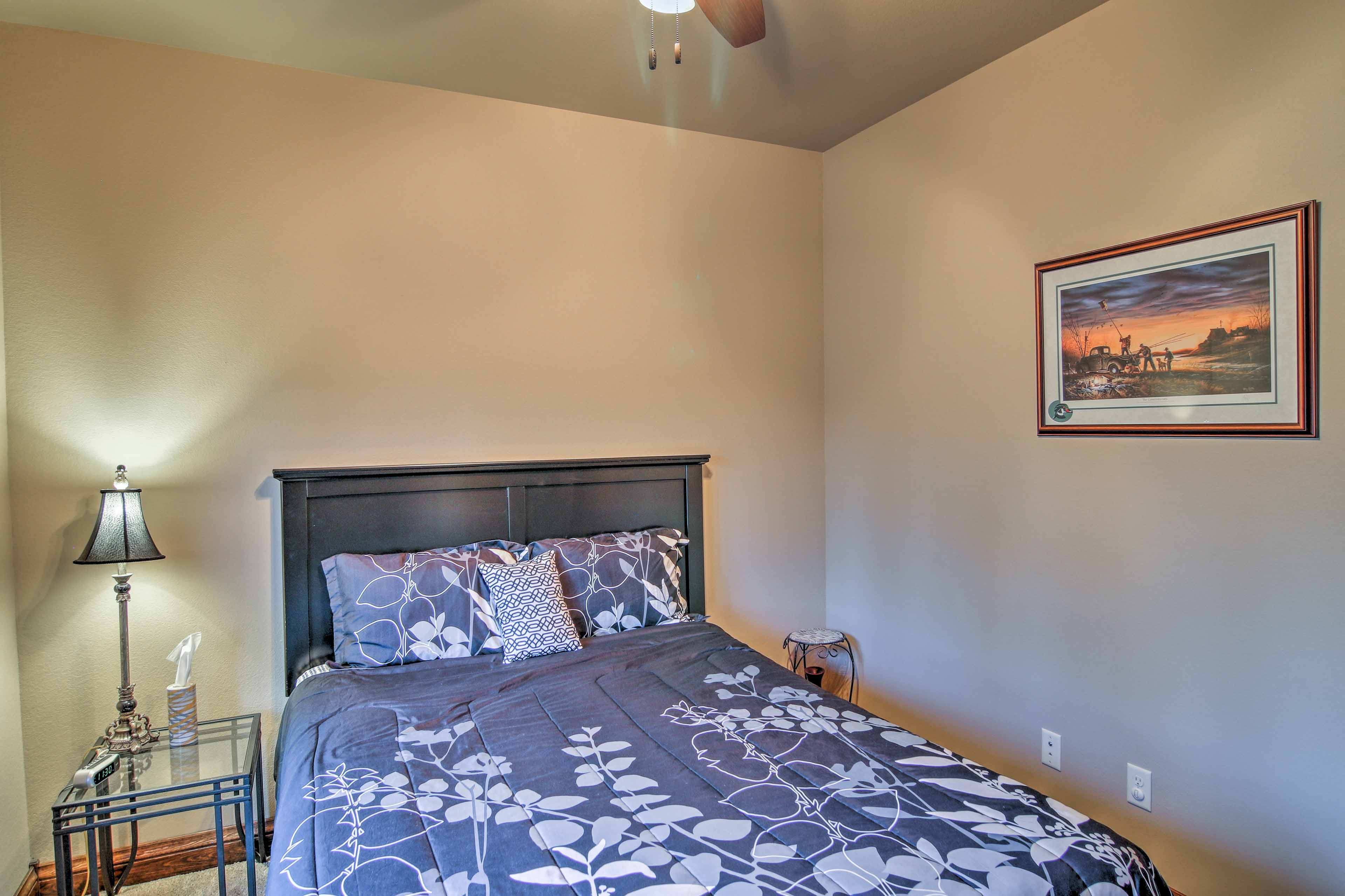 The second bedroom features a cozy queen-sized bed.