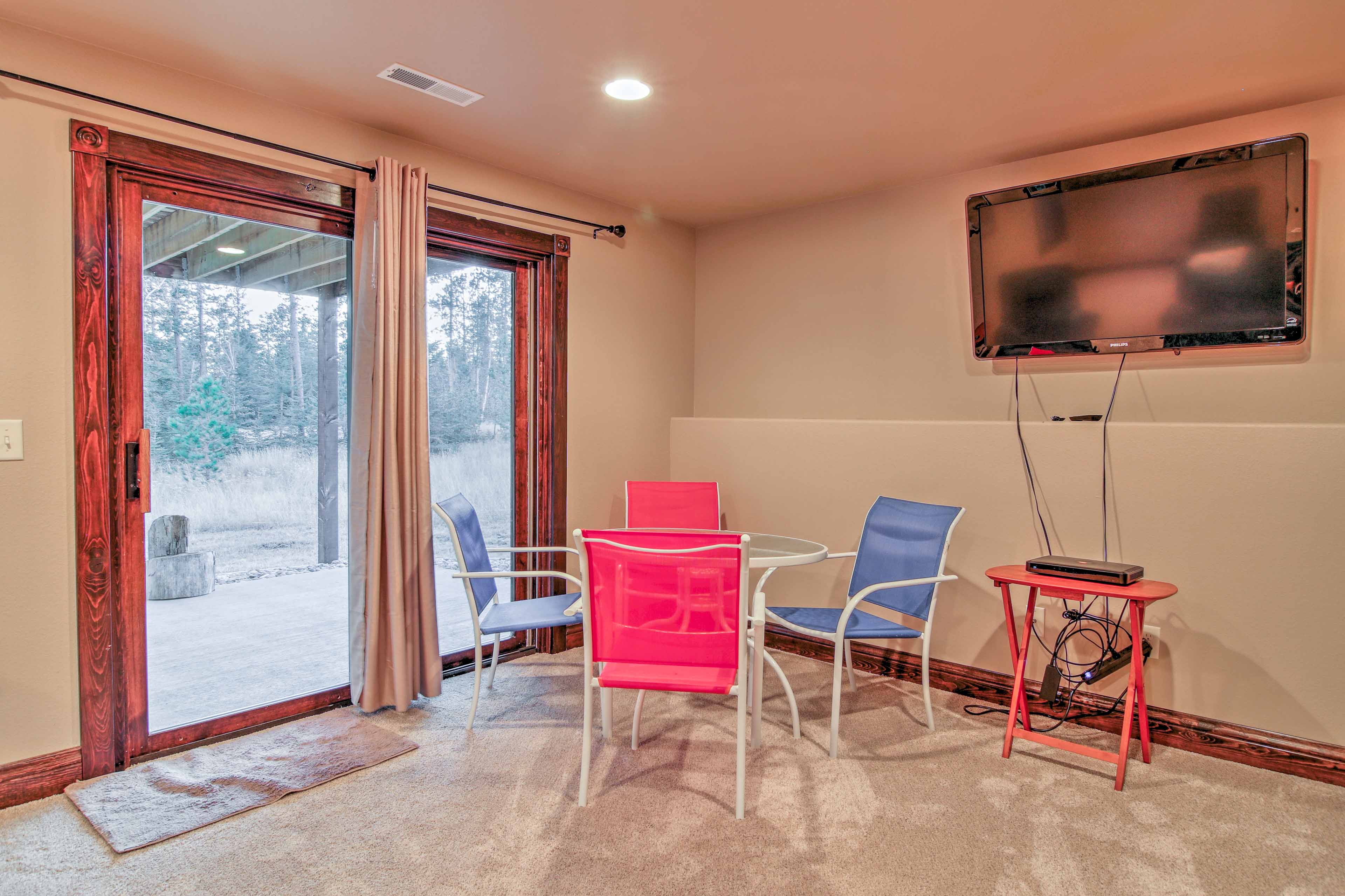 Play a quick game of poker or compete in a game on the flat-screen DirecTV in the basement space.