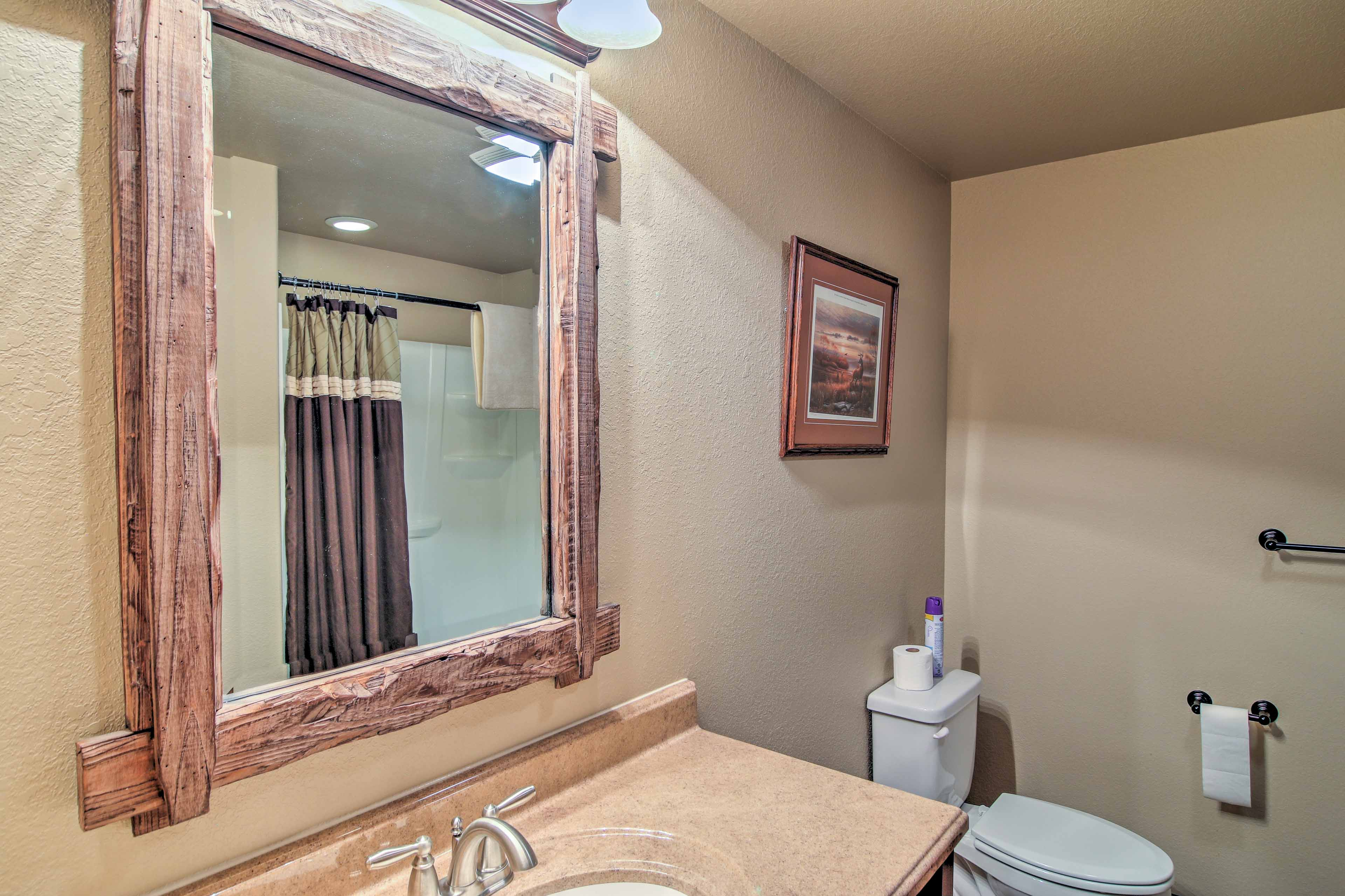 Rinse off in the single vanity and shower/tub combo found in the third bathroom.
