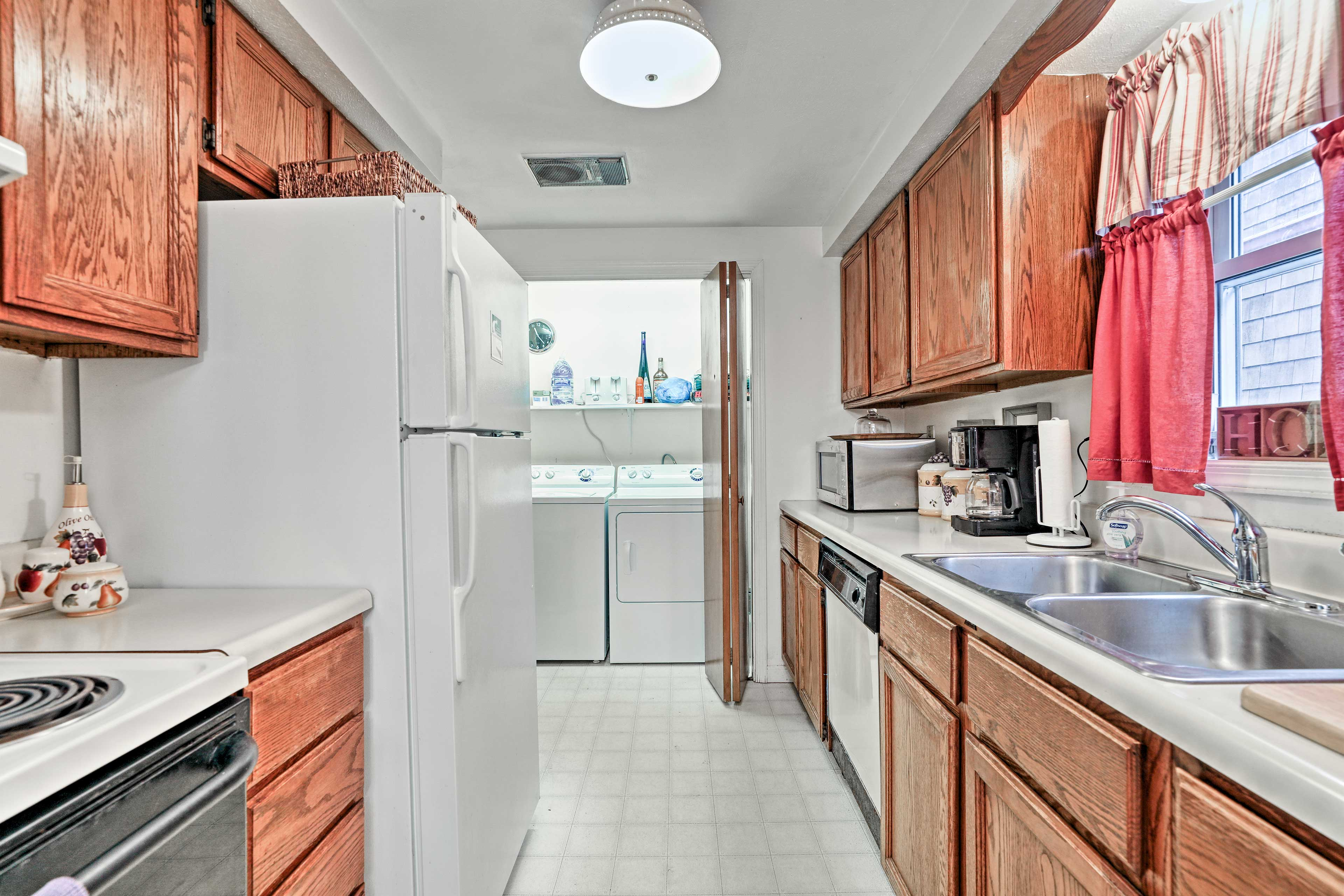 The kitchen is fully equipped with updated appliances and ample counter space.
